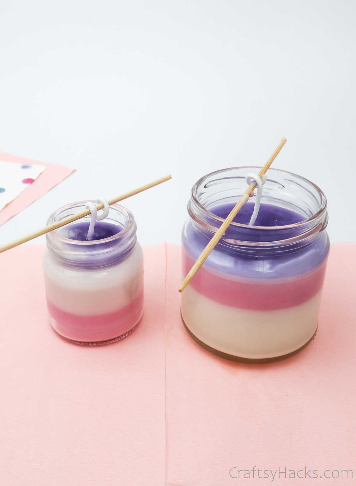 two jars filled with coloured wax