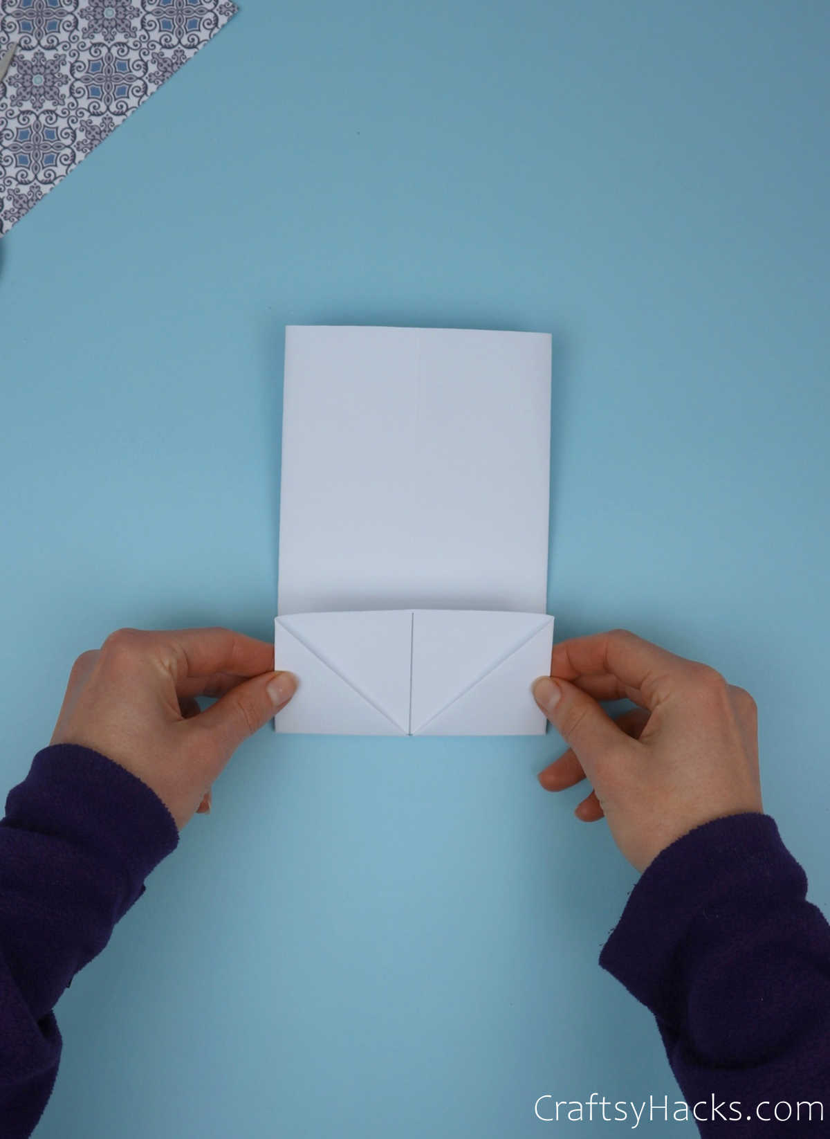 folding up bottom of paper