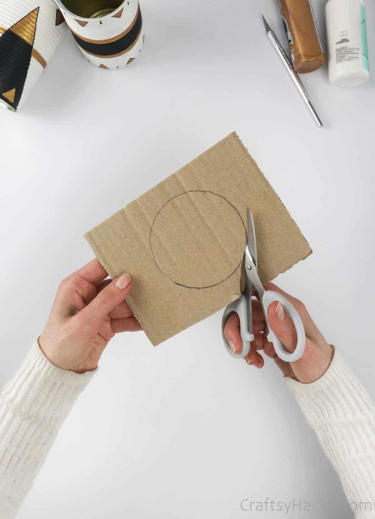 cutting out cardboard circle