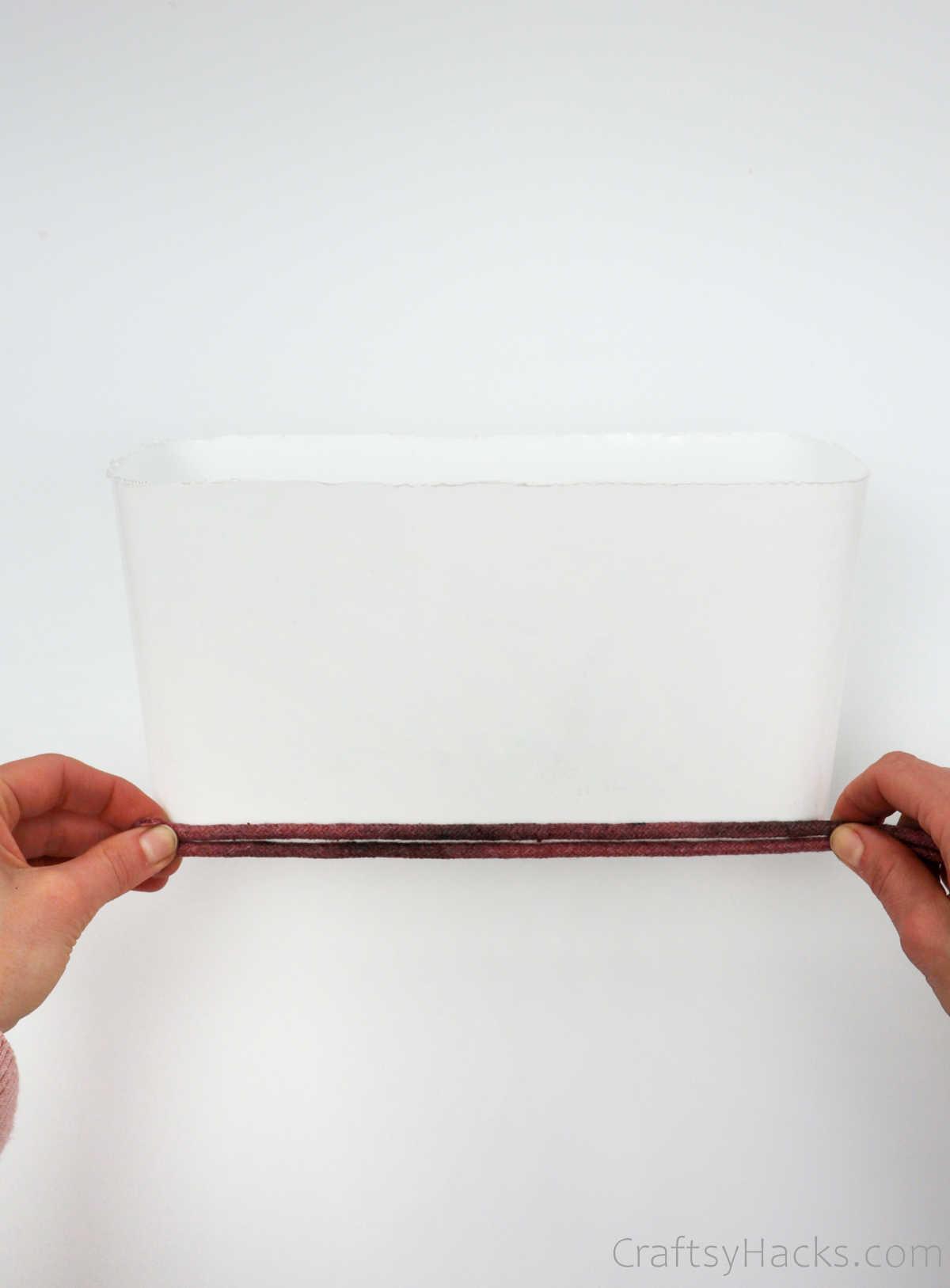 wrapping rope around box