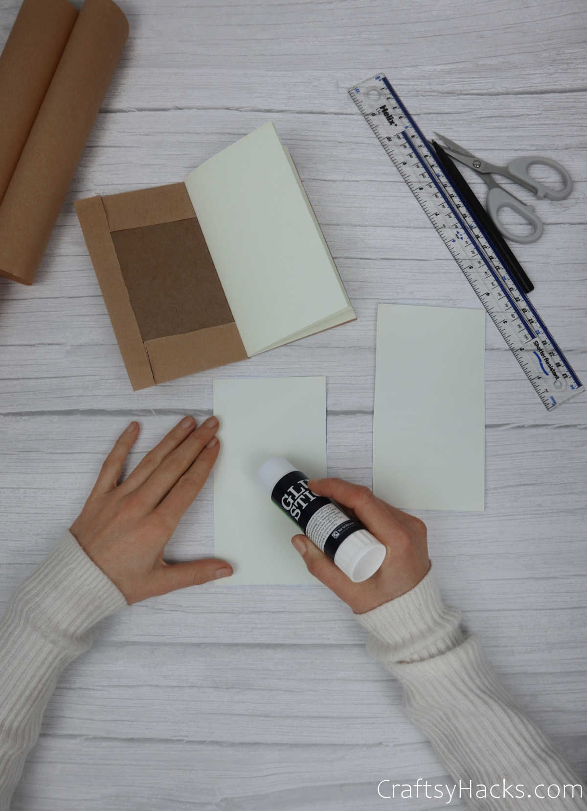 adding glue to paper rectangles
