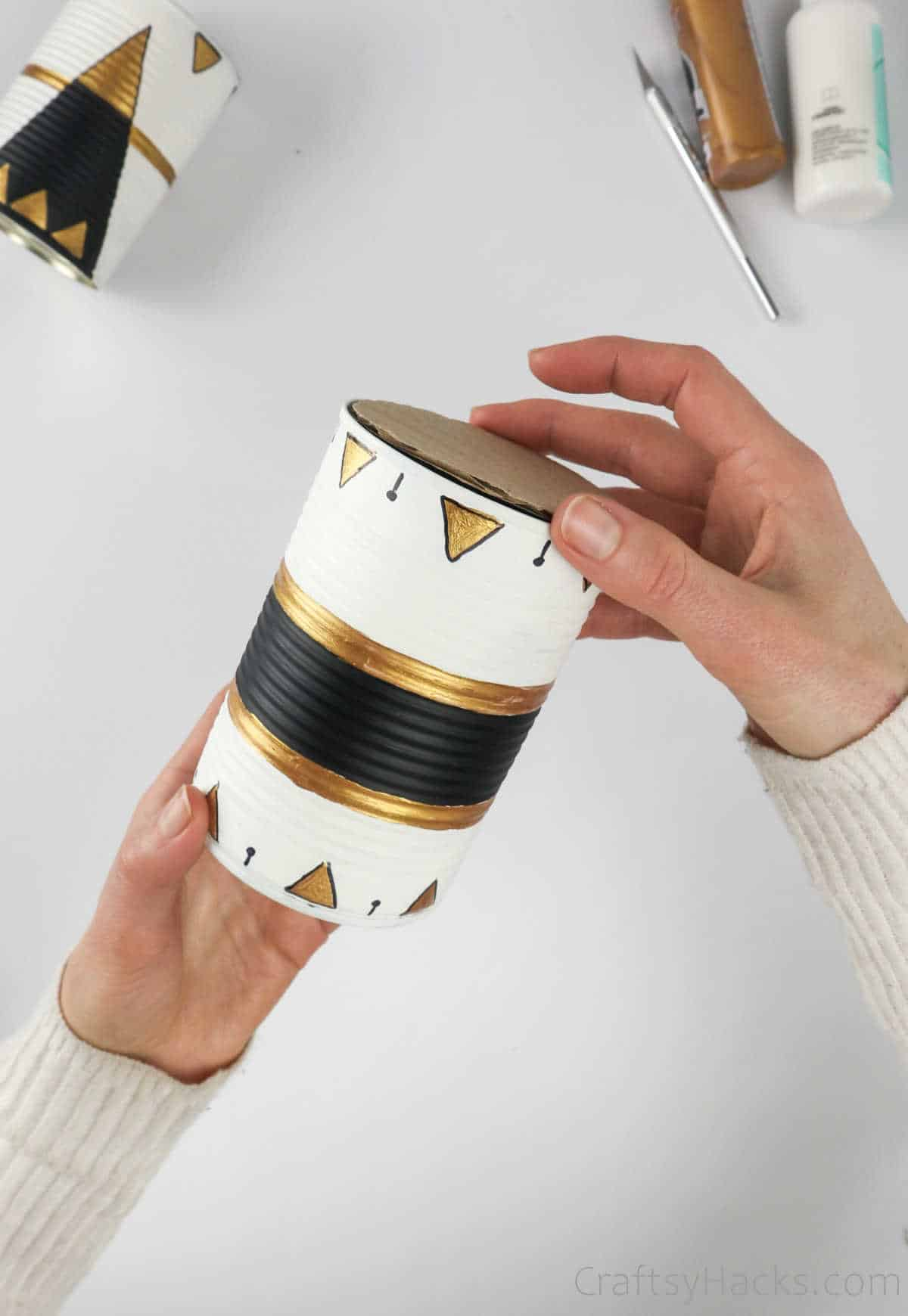 adding lid to tin can