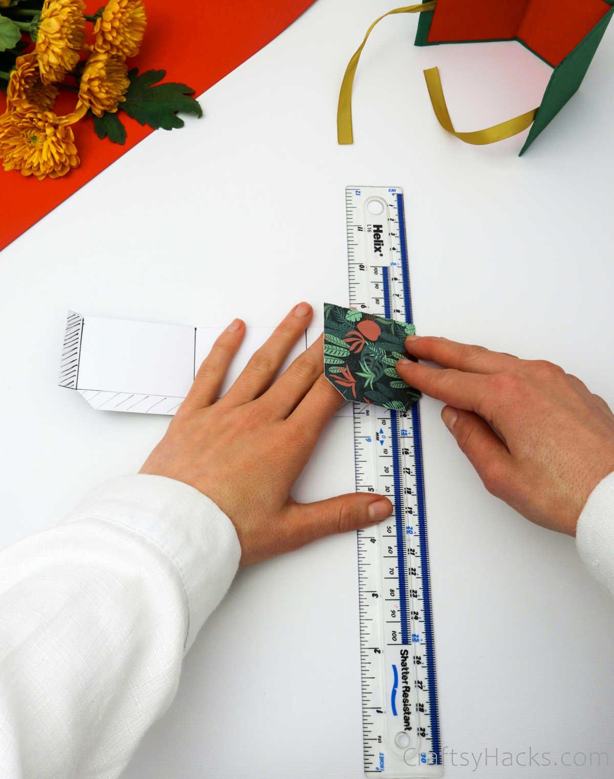folding paper over ruler