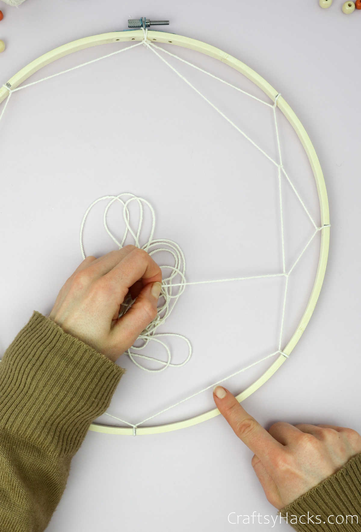 wrapping string around first string