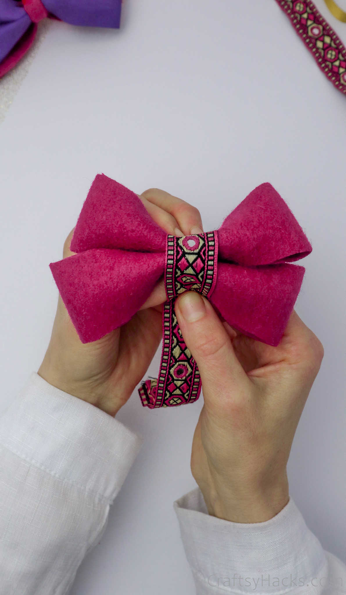 wrapping ribbon around bow