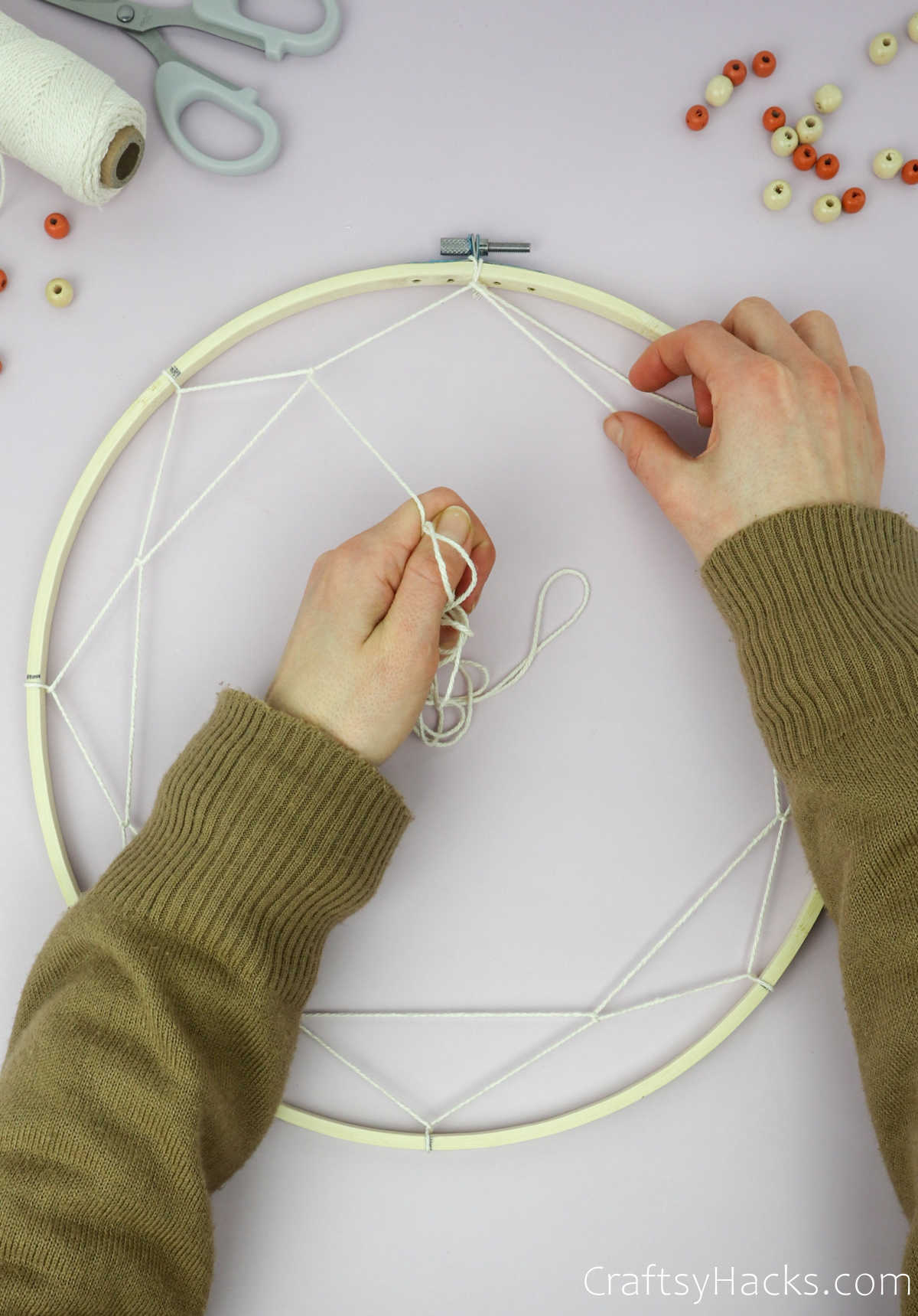 wrapping string around top string