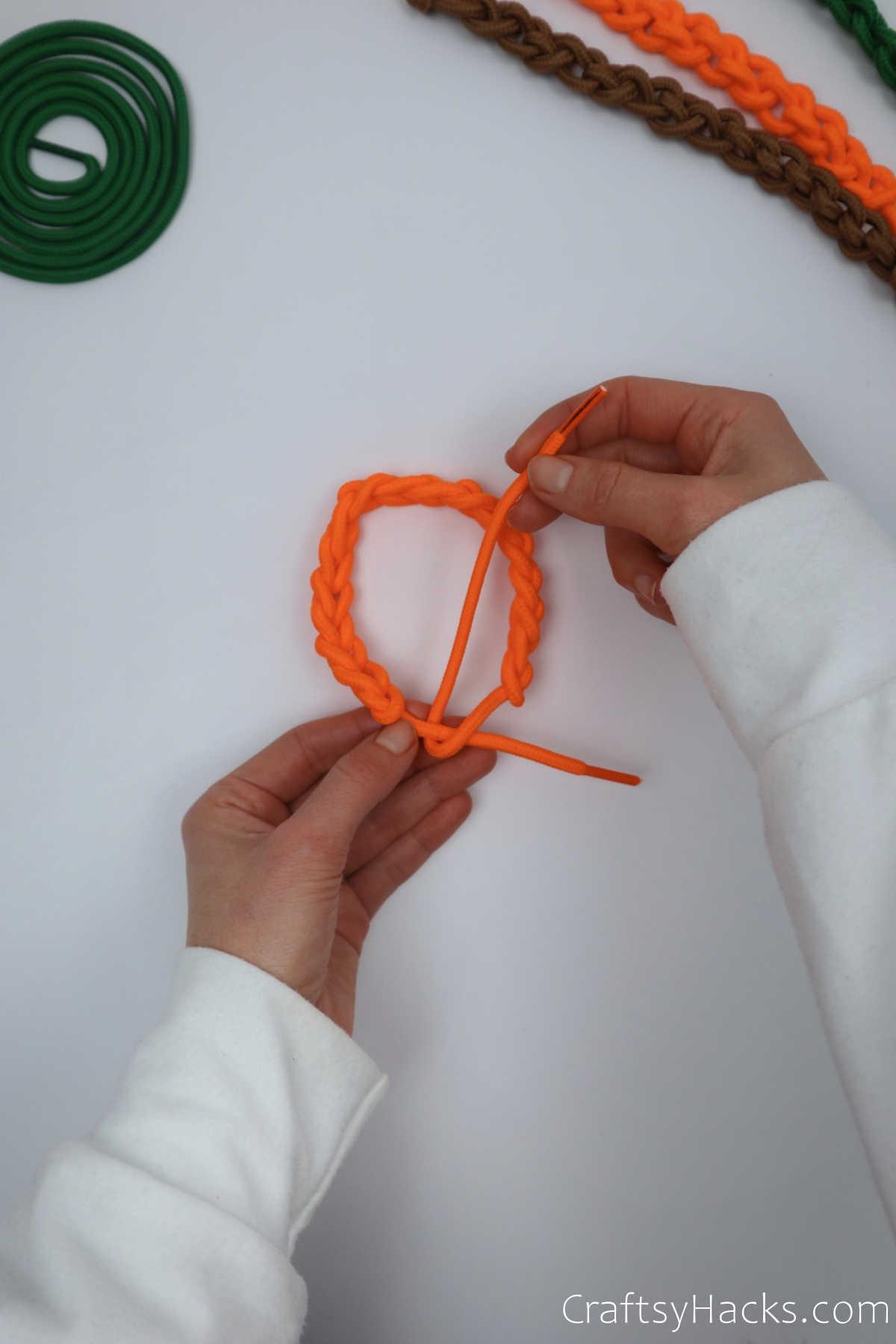 tying bracelet together