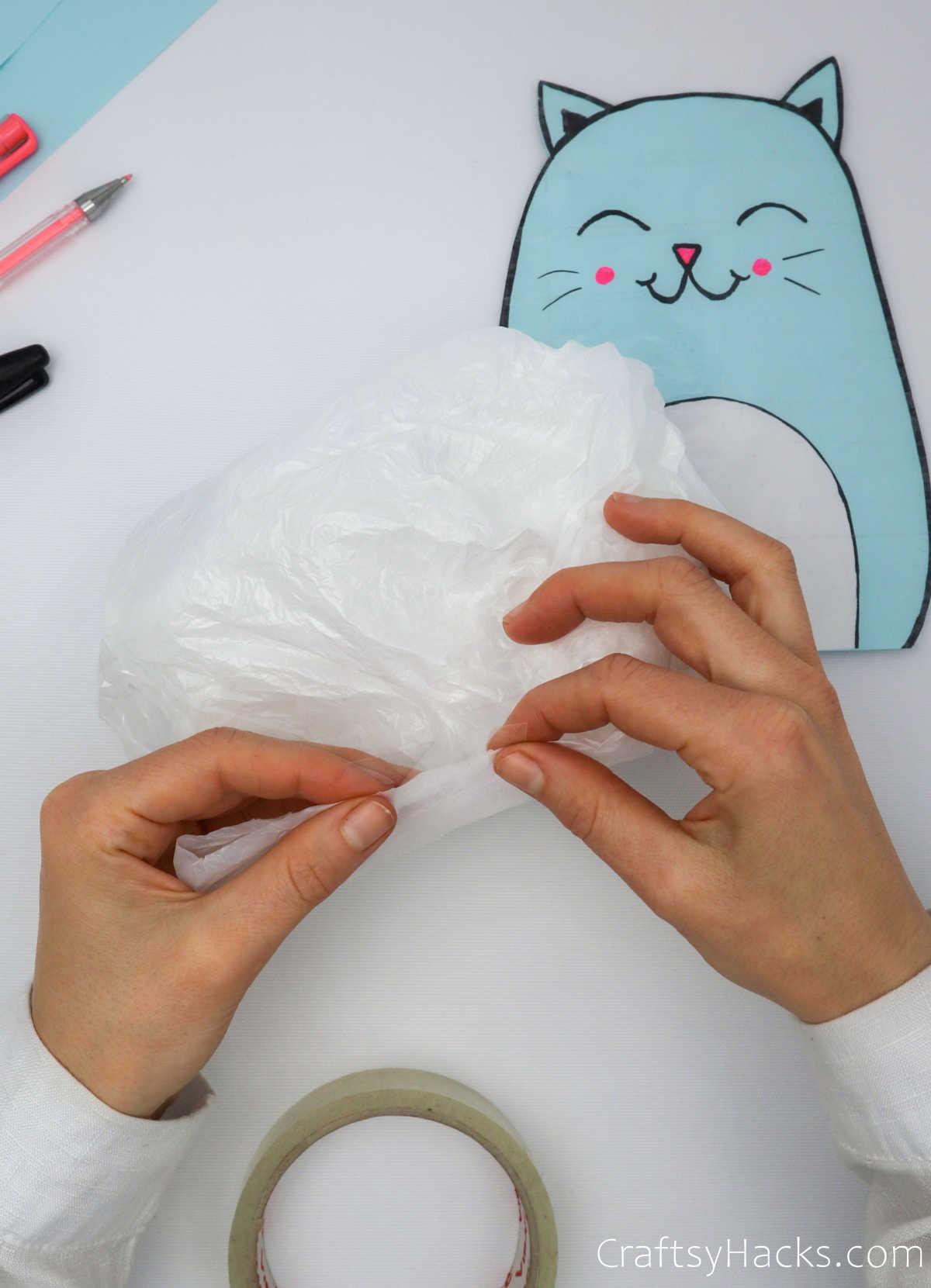 adding stuffing to bag