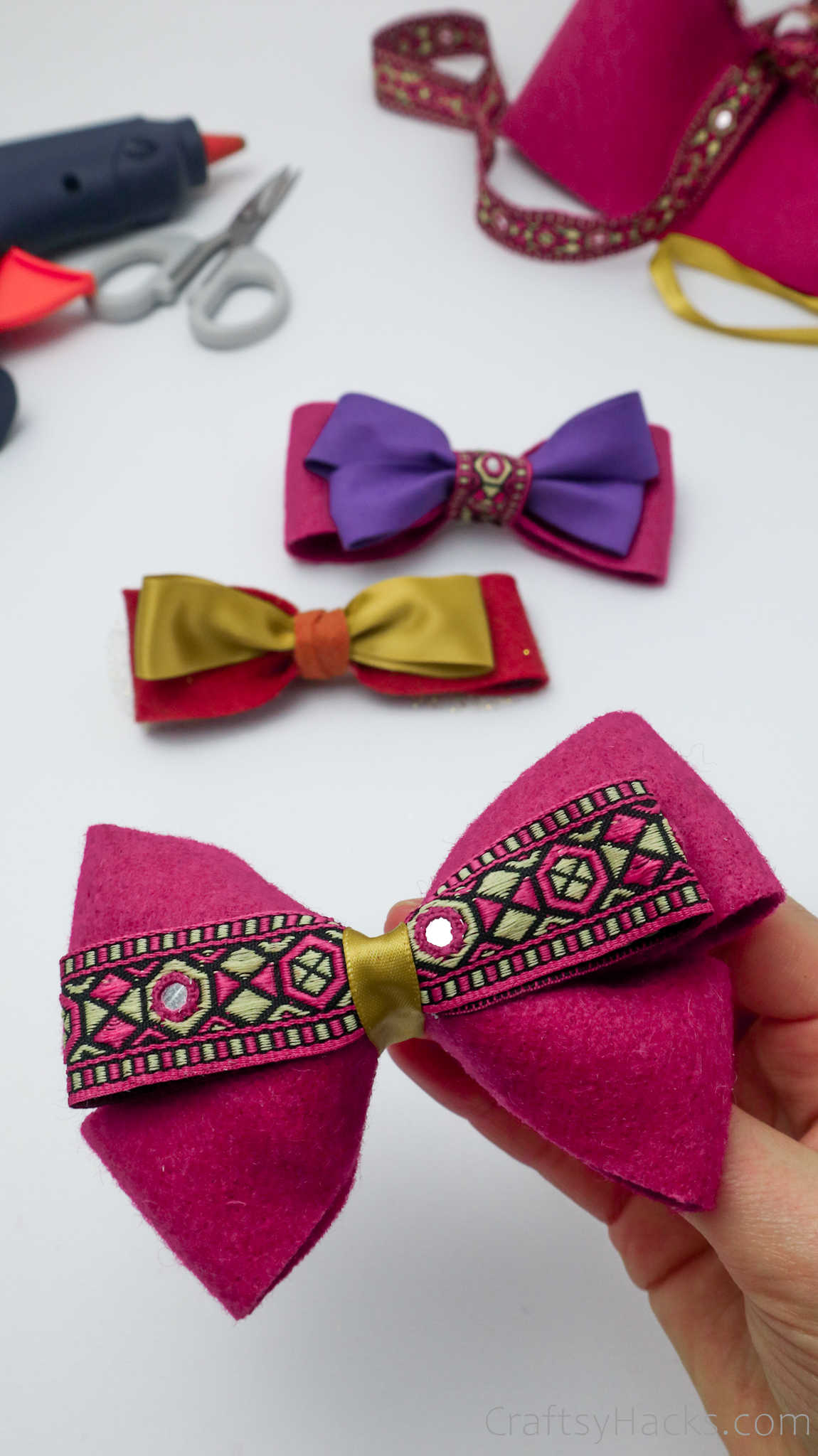 holding pink hair bow
