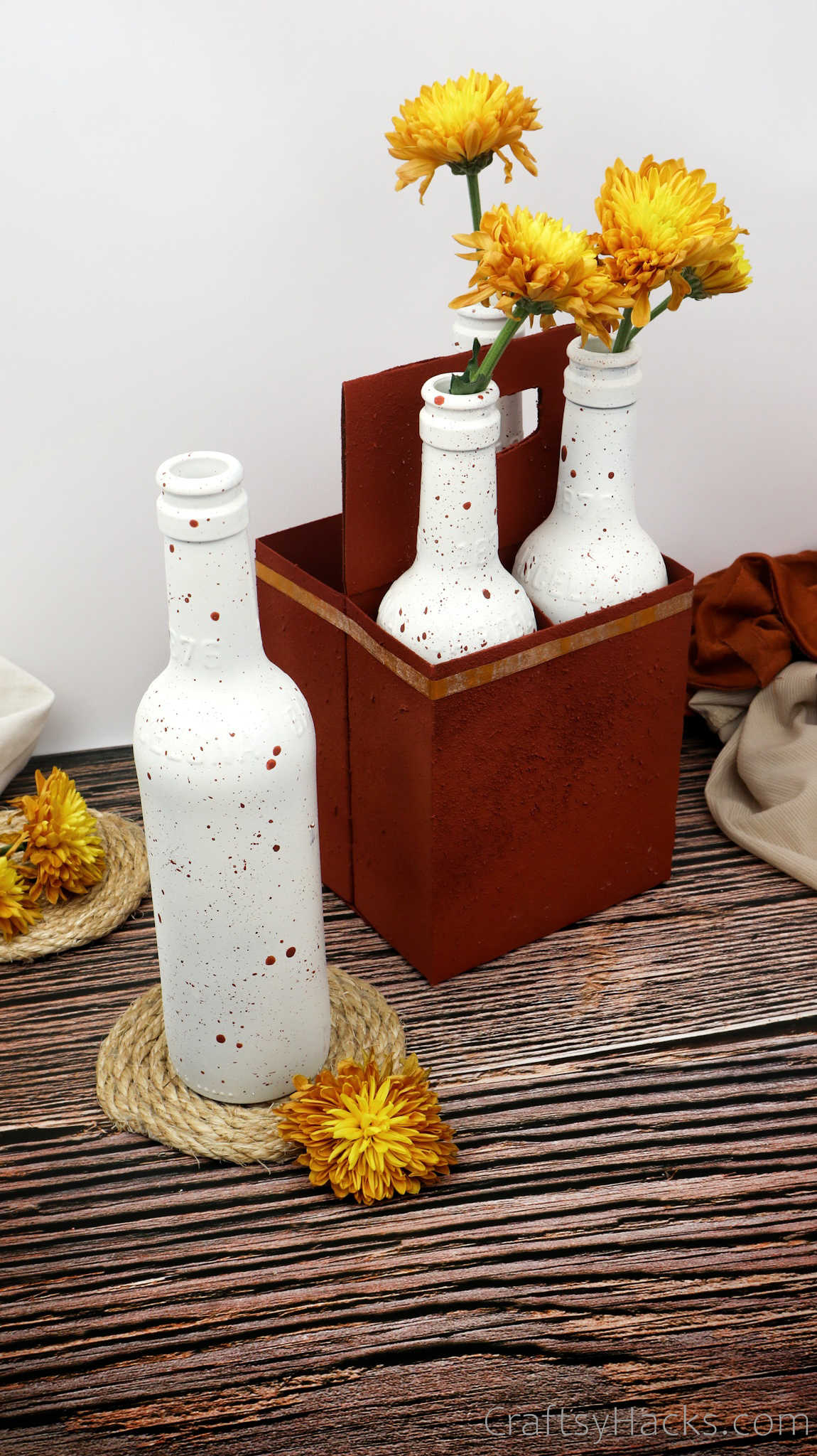 upcycled bottle with flowers