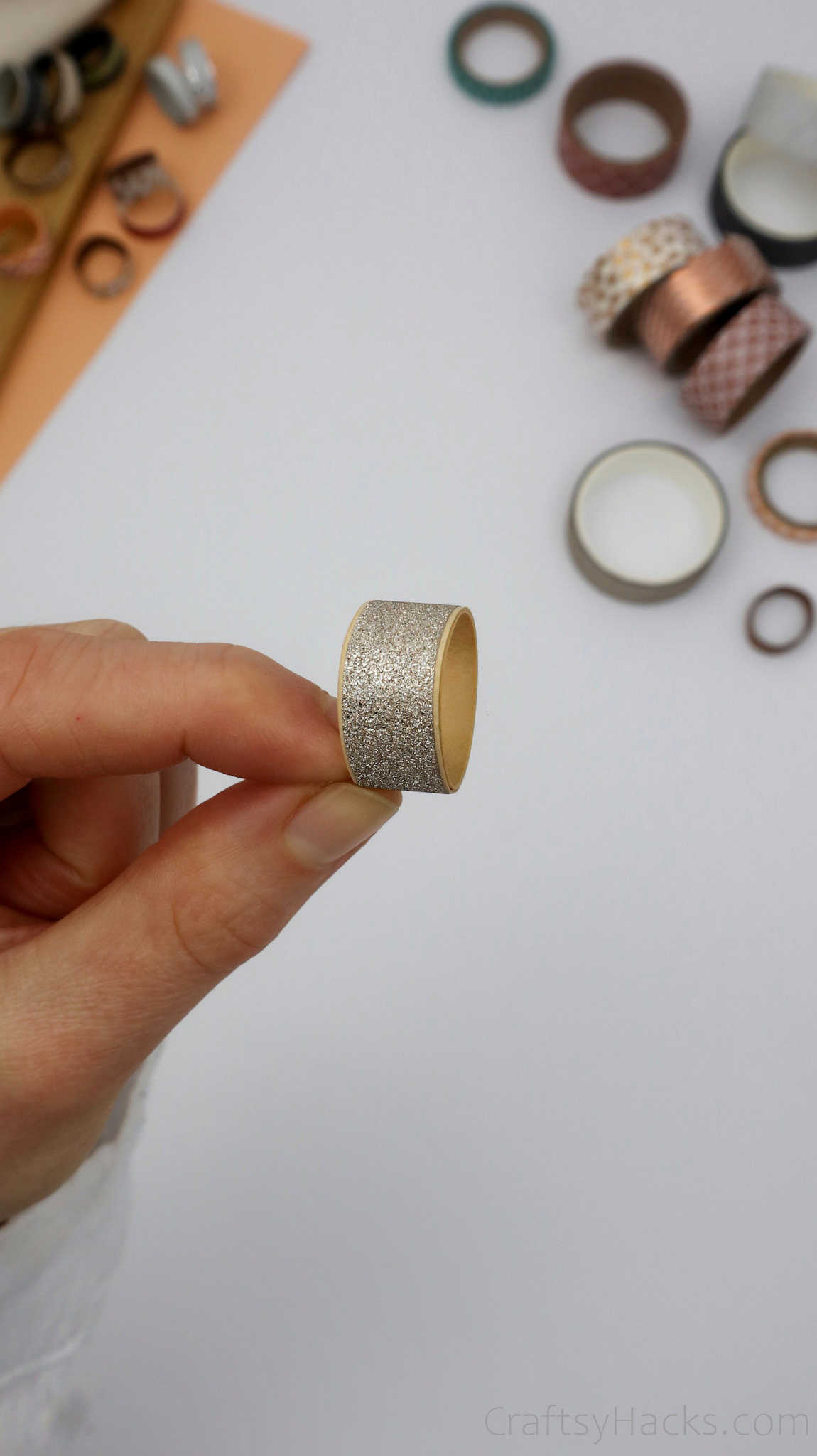 holding silver paper ring