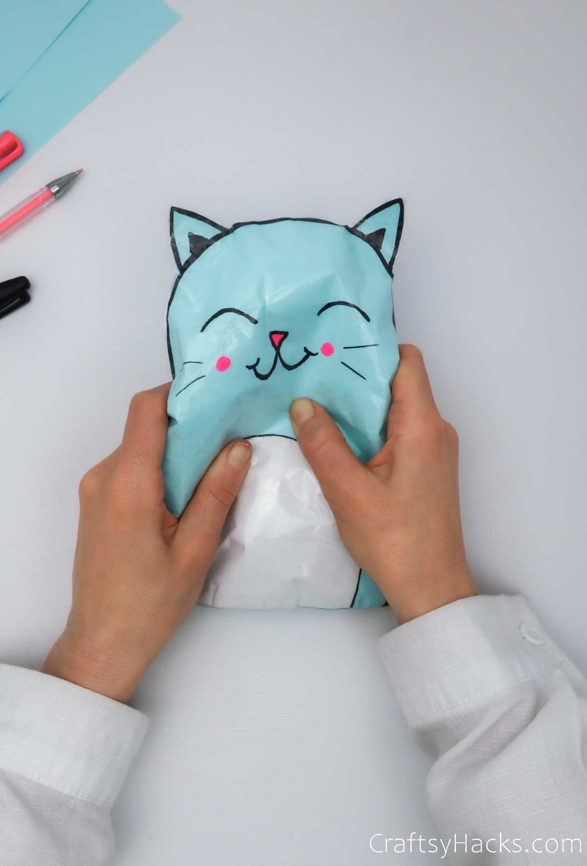 squishing paper cat squishie