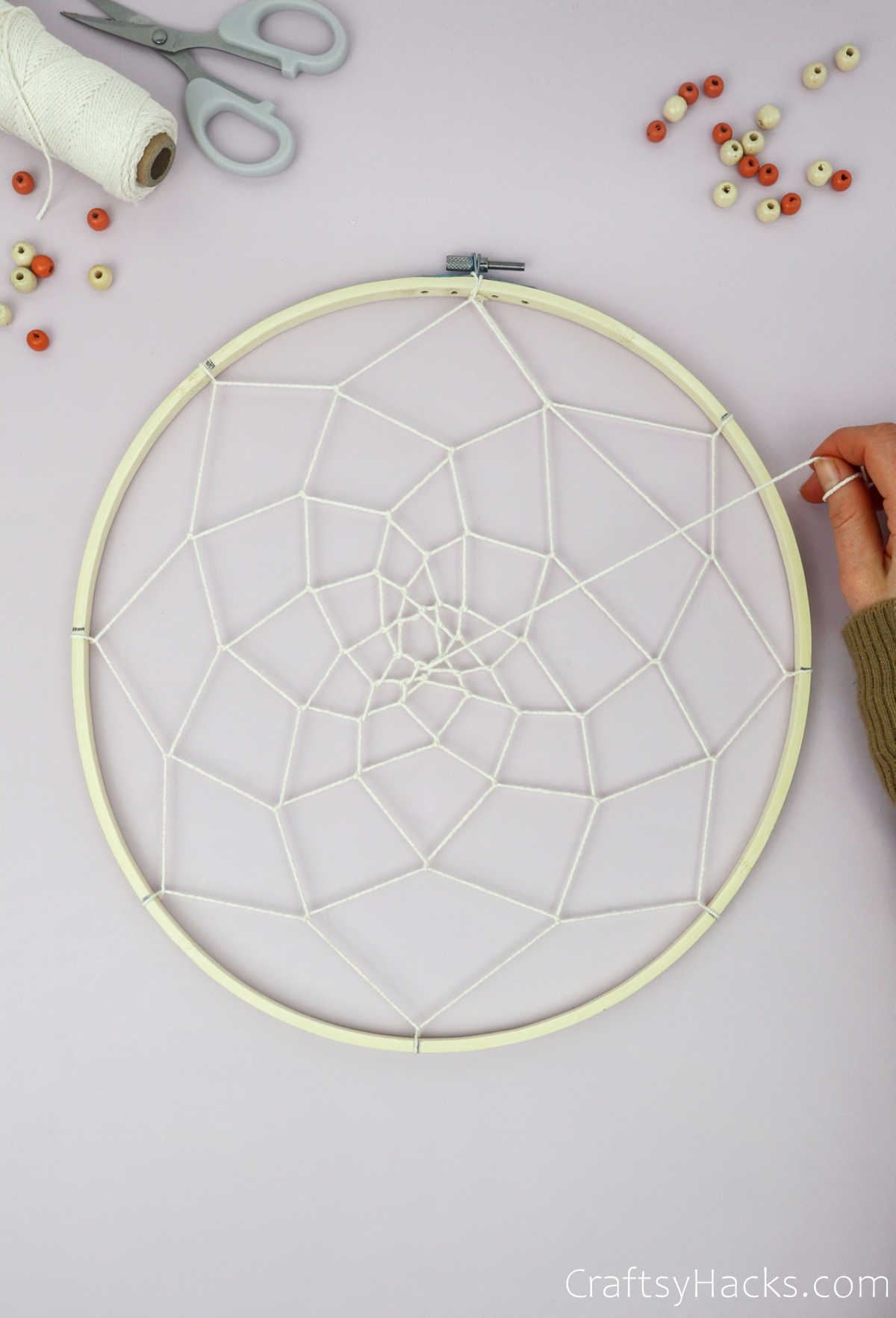 attaching string in middle of hoop