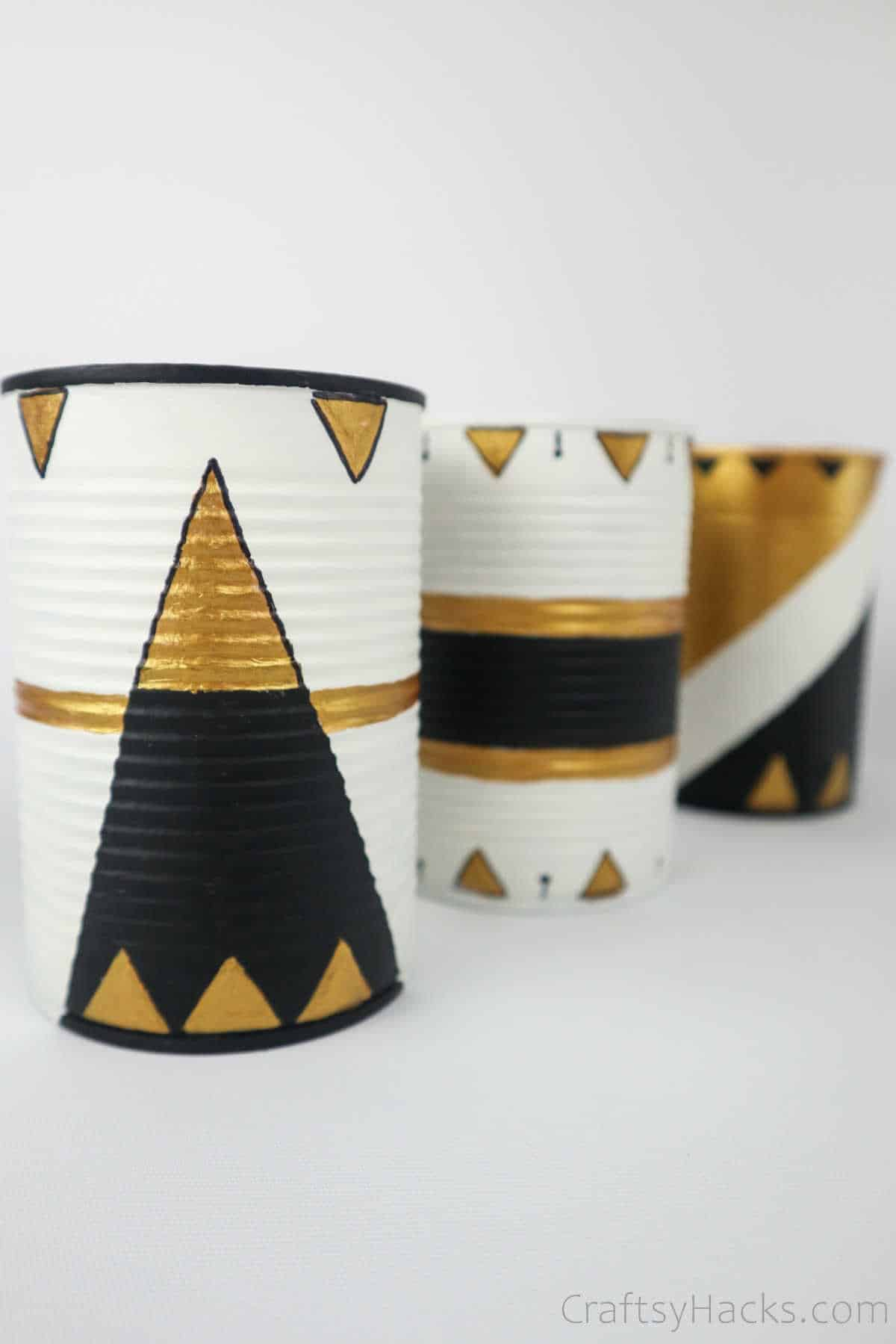close up decorated tin cans