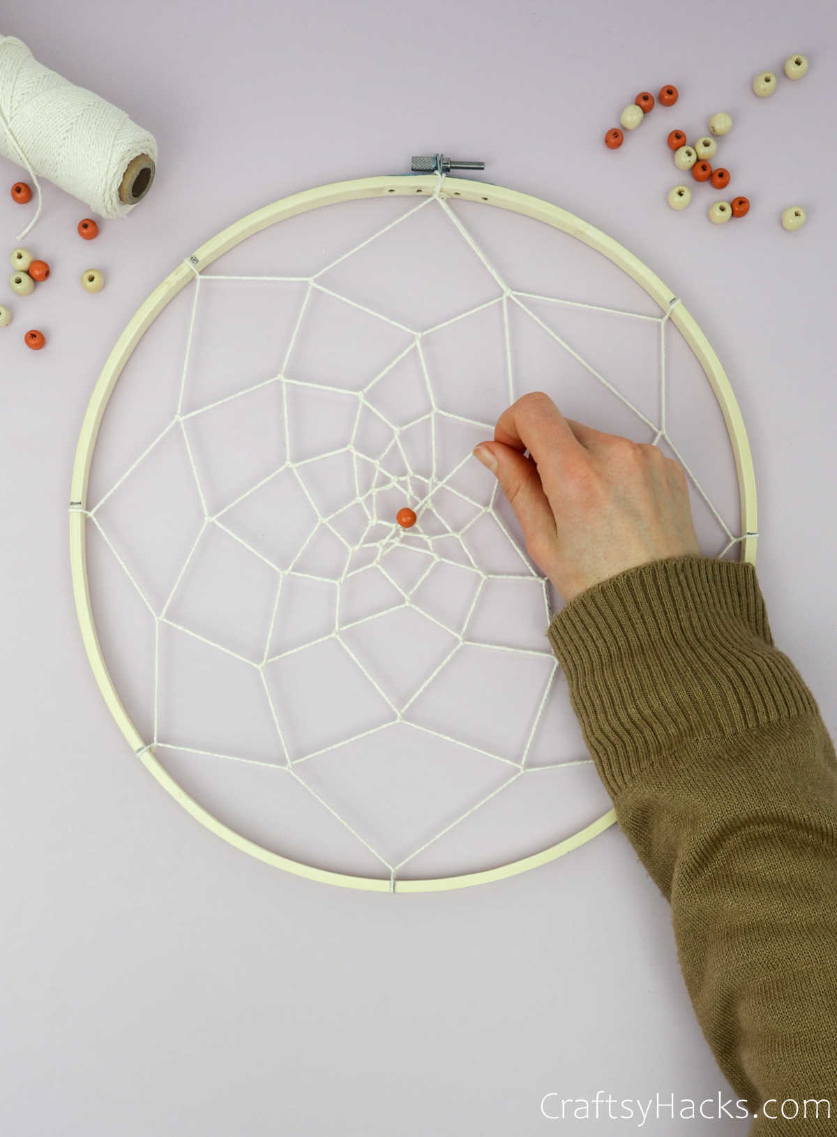putting beads on string