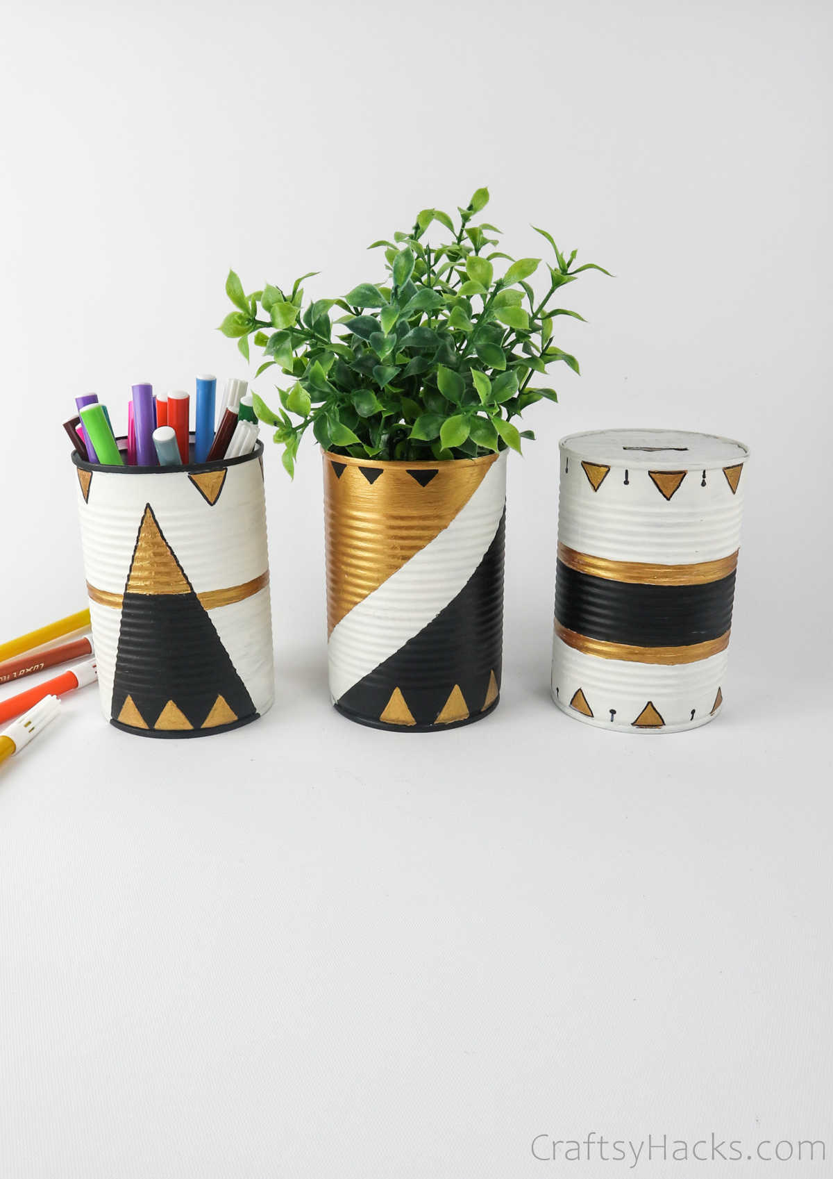 tin cans with pens, and plant