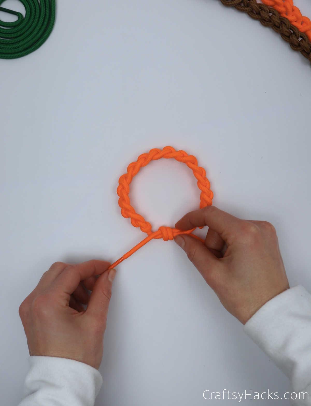 holding end of shoelace bracelet