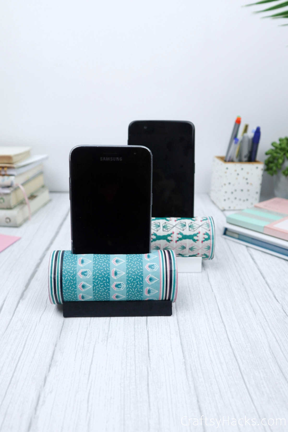 paper roll phone holders with phones