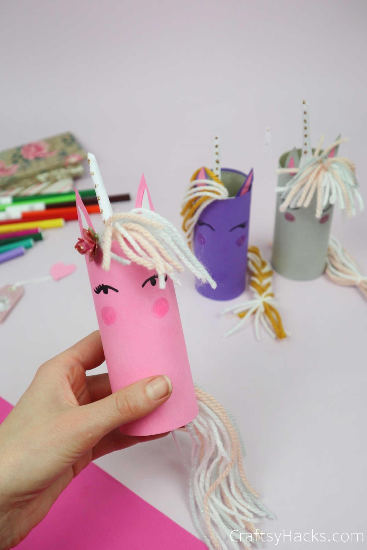 holding pink unicorn