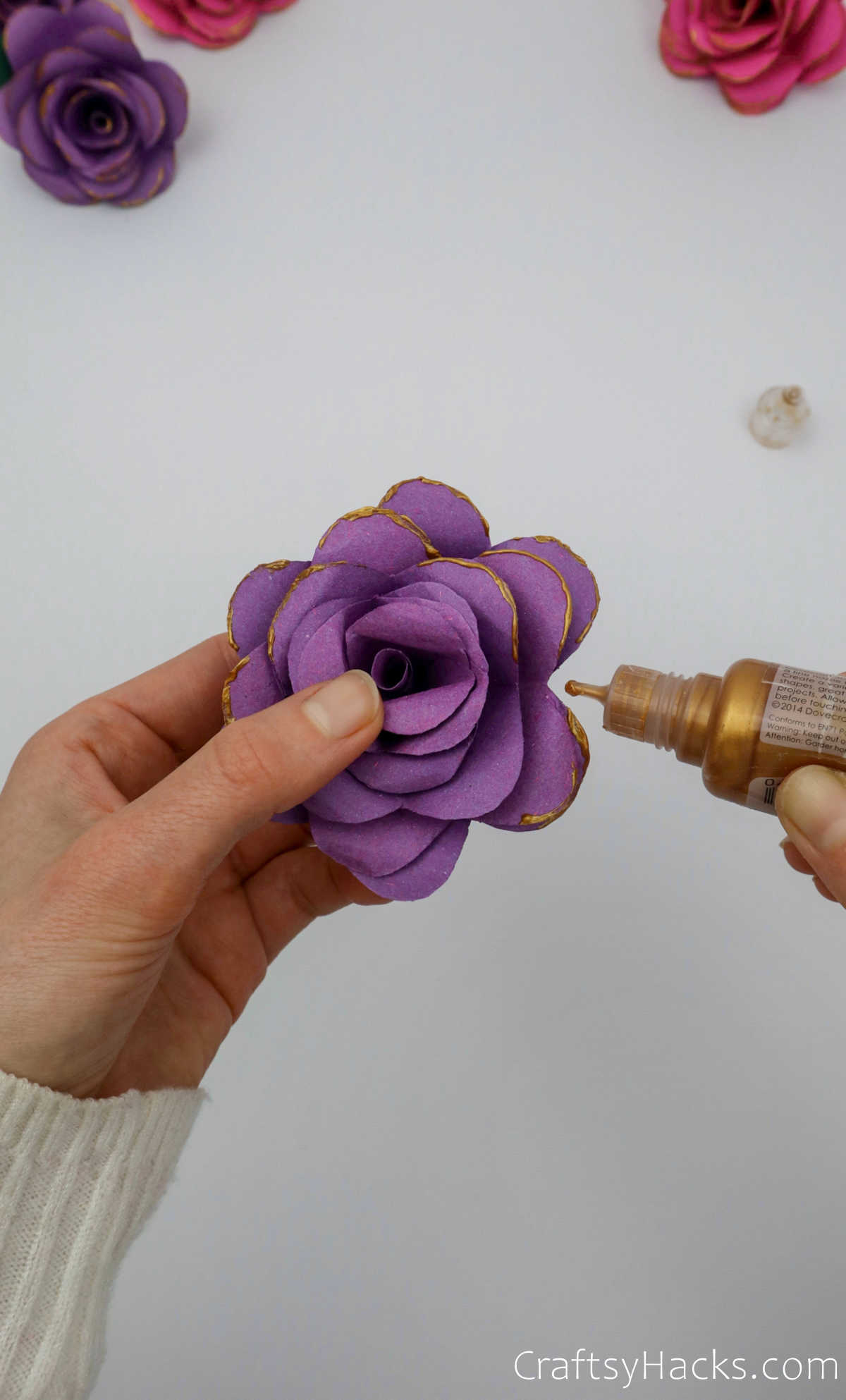 adding gold paint to flower