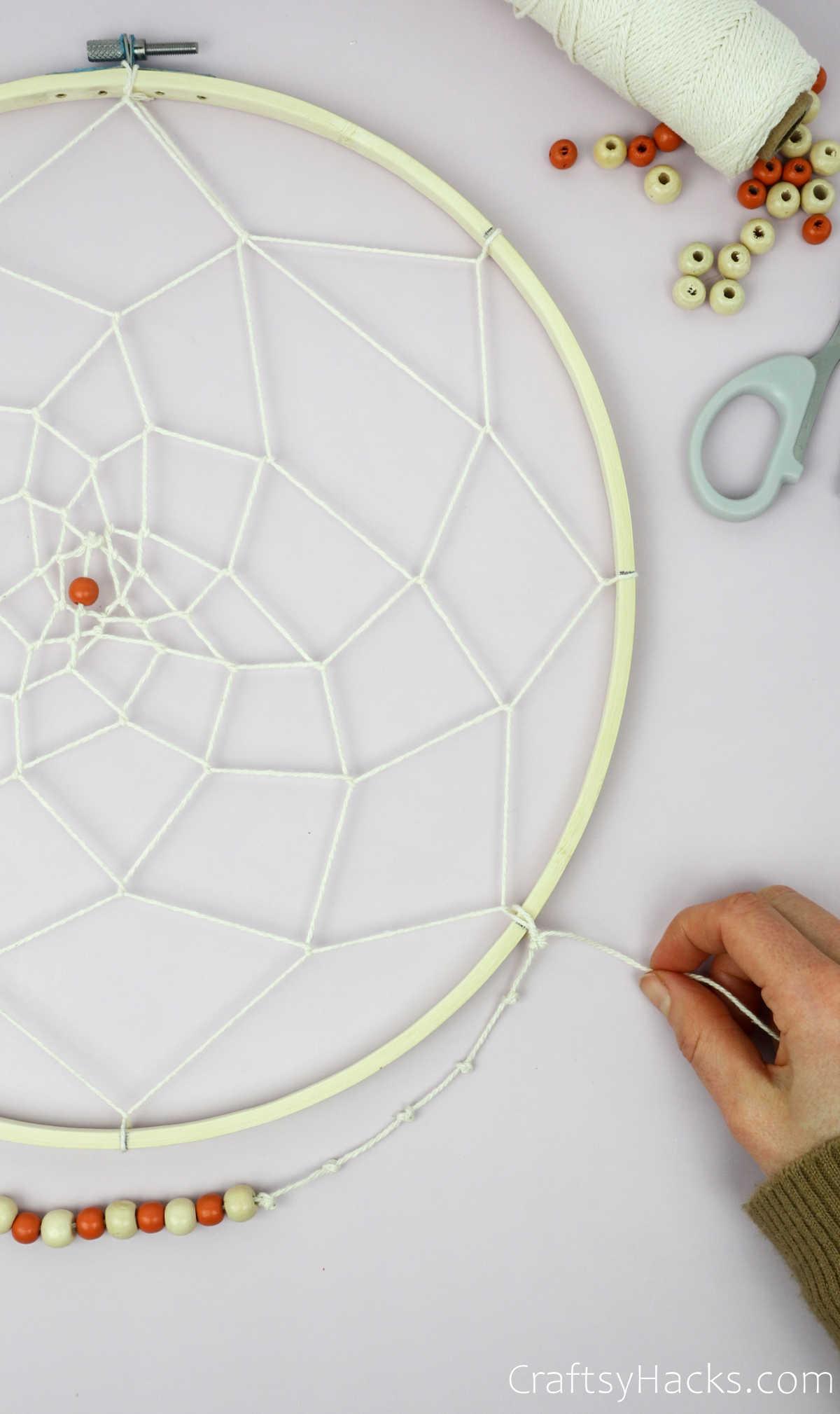 tying string to hoop