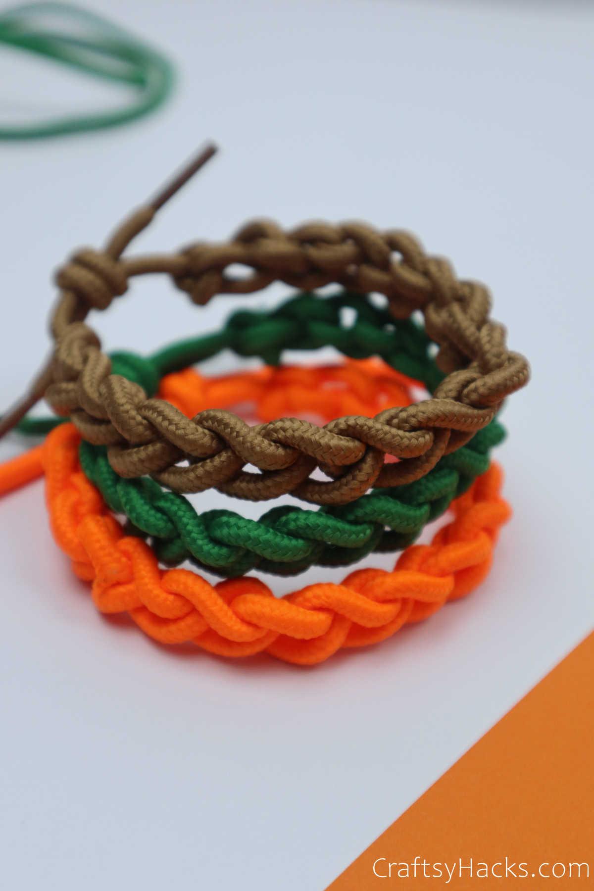 three stacked bracelets