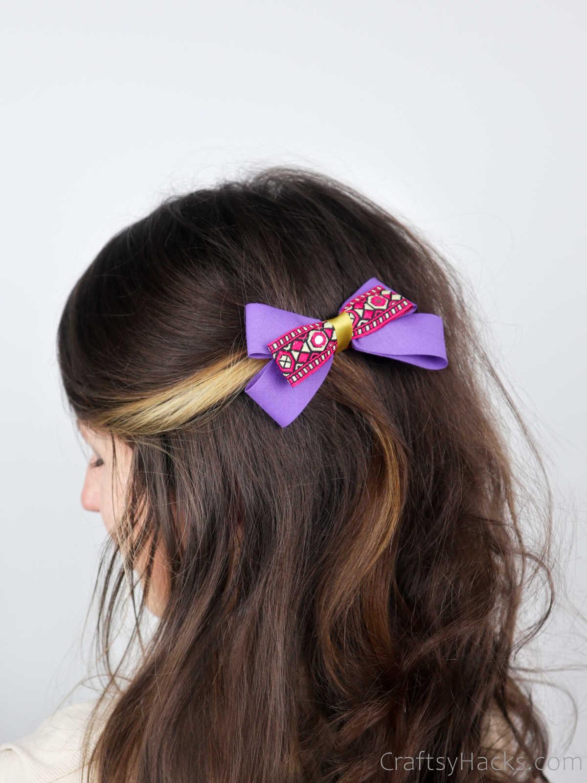 purple hair bow in hair