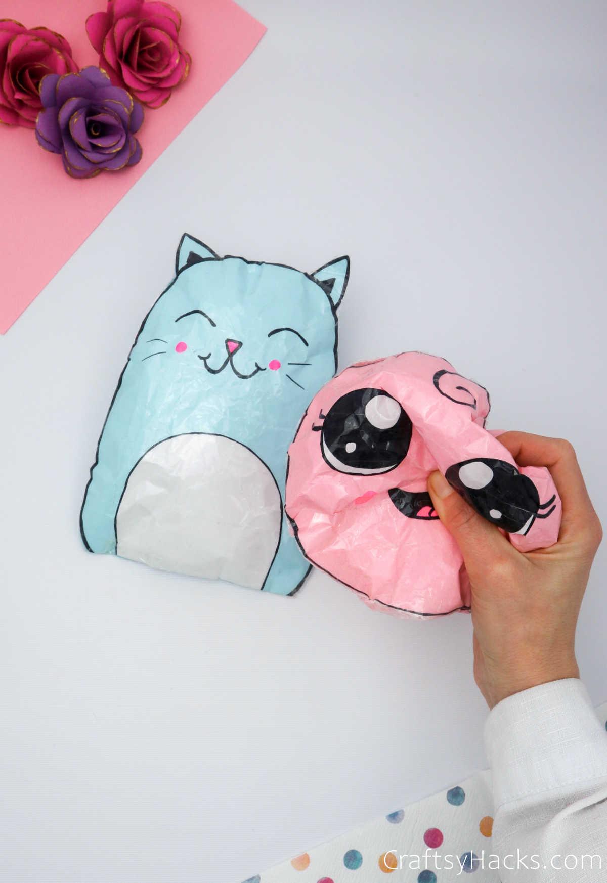 holding pink squishie