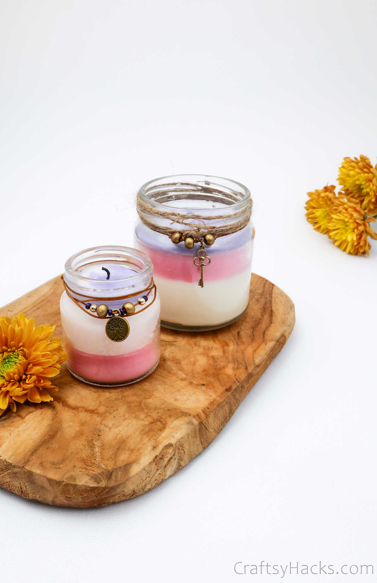 two candles on wood