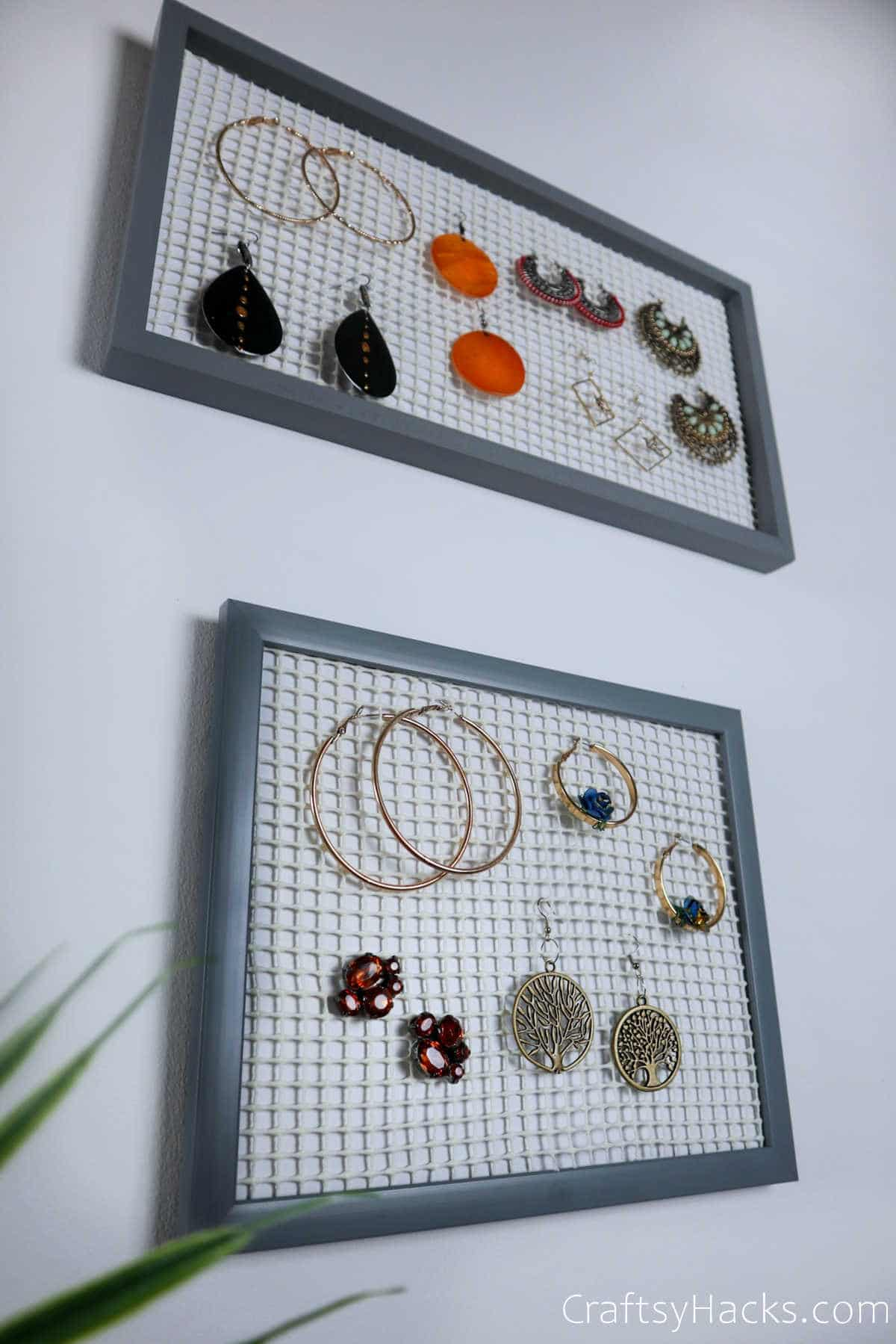 earring organizers hanging on wall