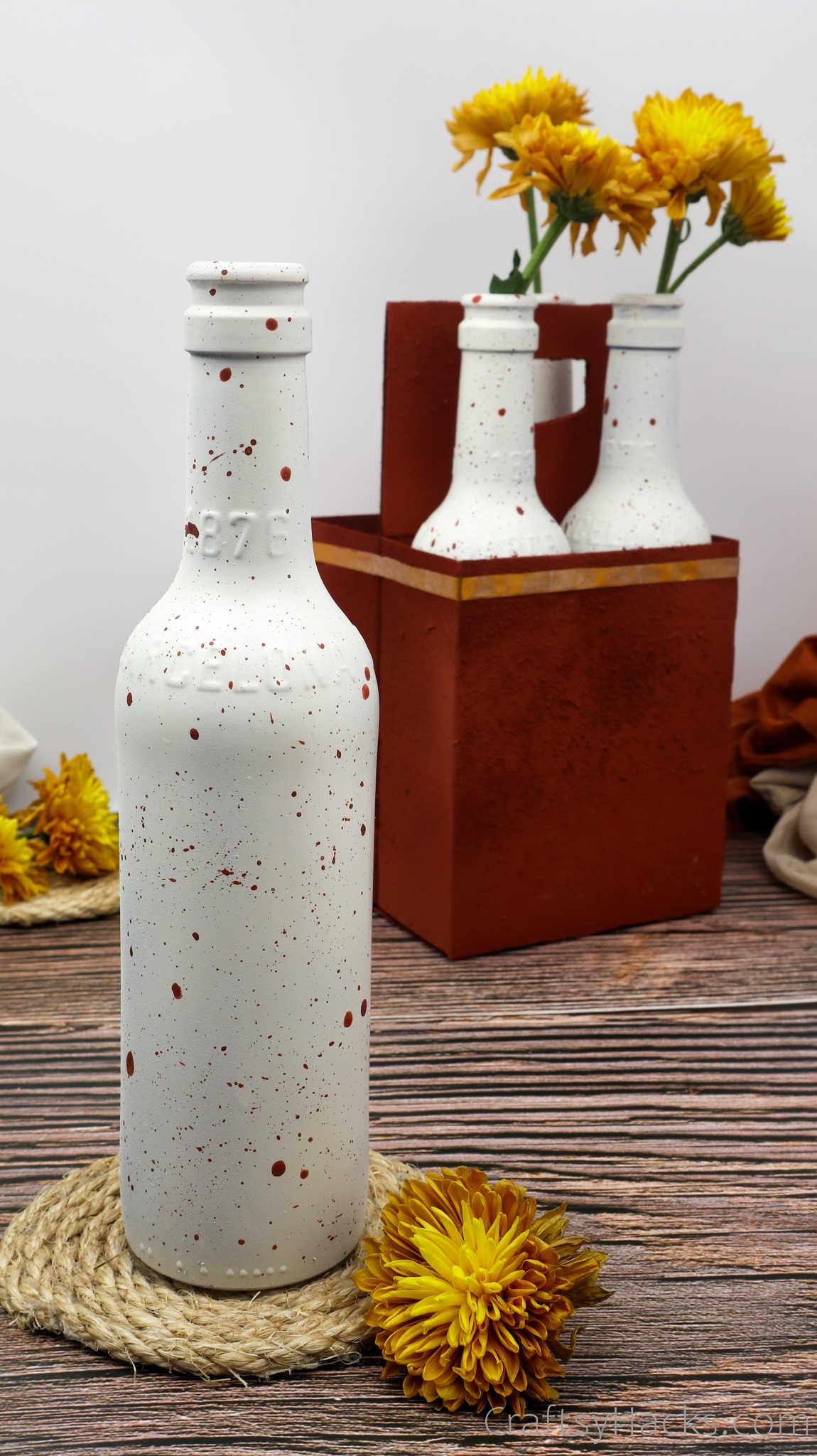 bottle with paint splatter