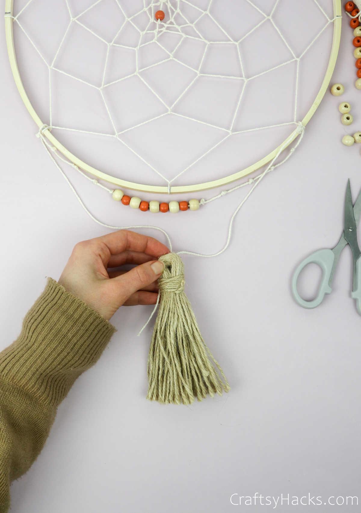 attaching tassle to string