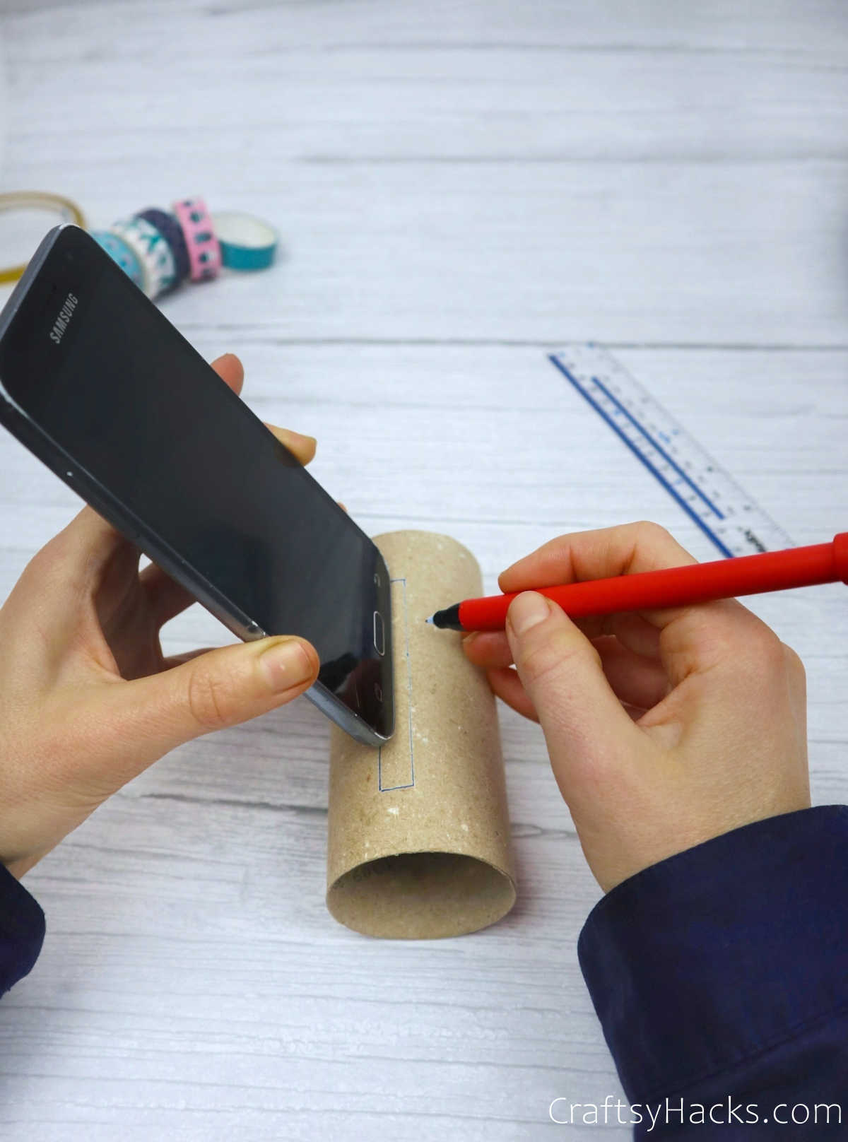 tracing phone onto paper roll