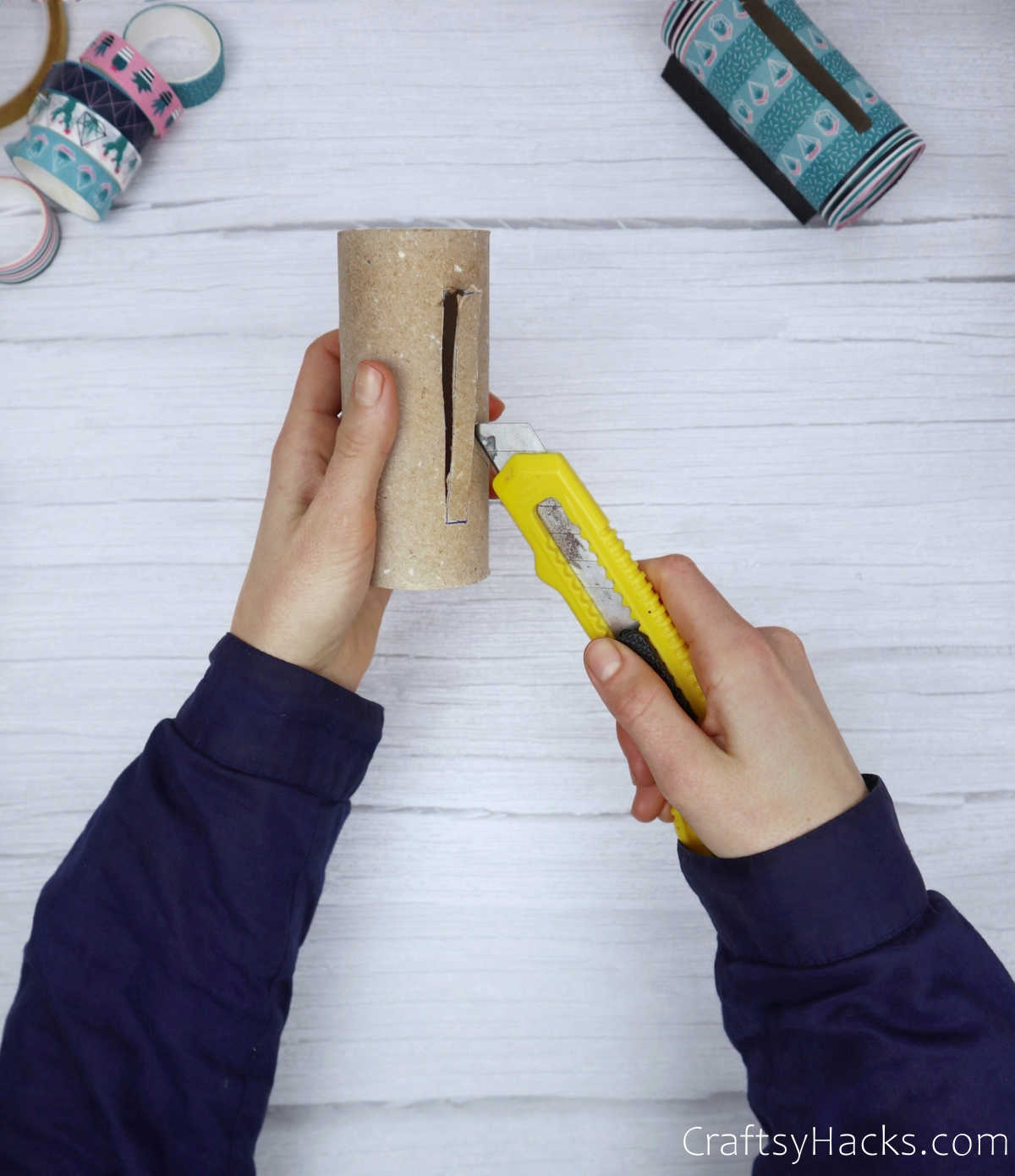 cutting slot in paper roll