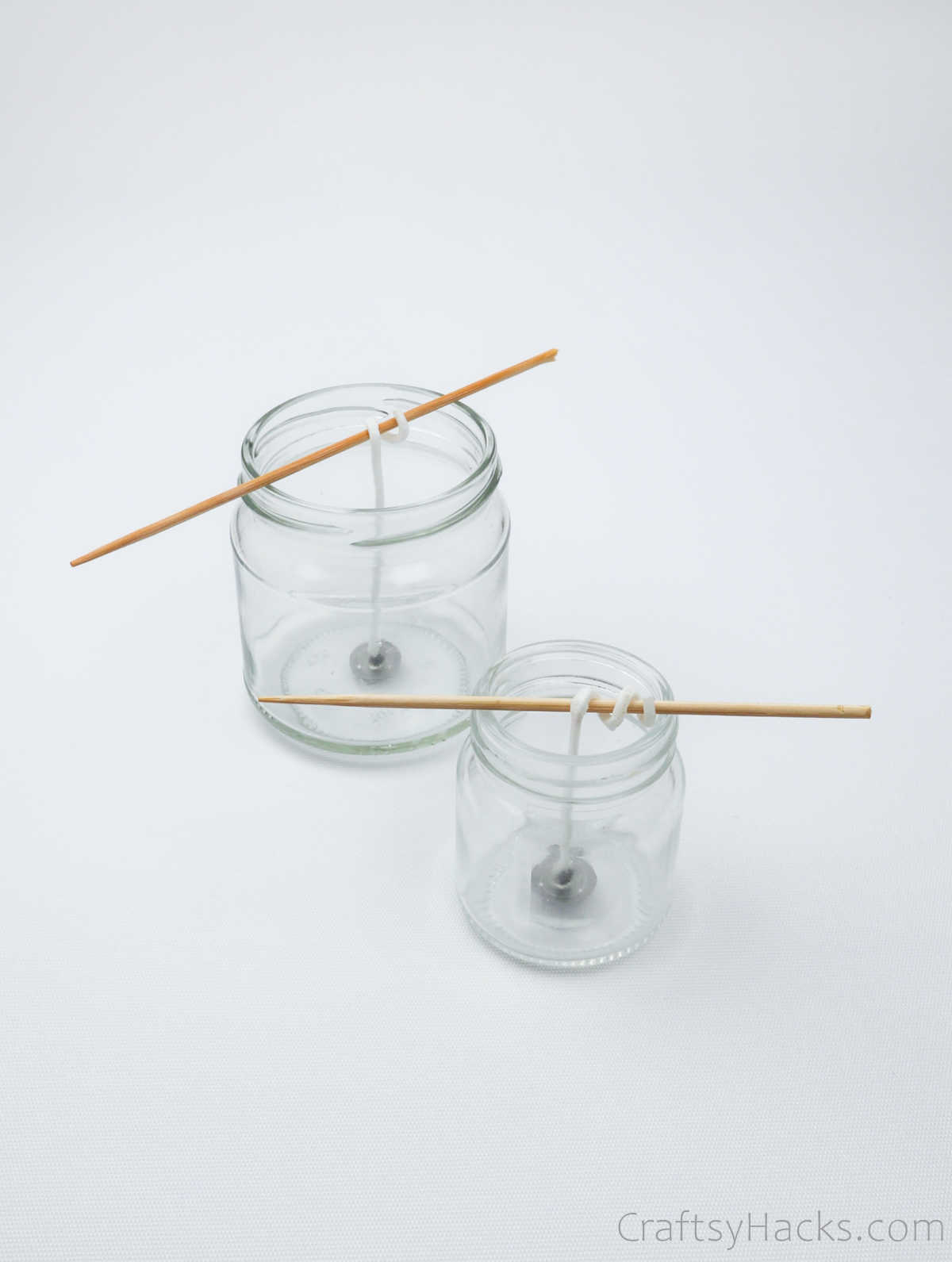 two jars with wicks