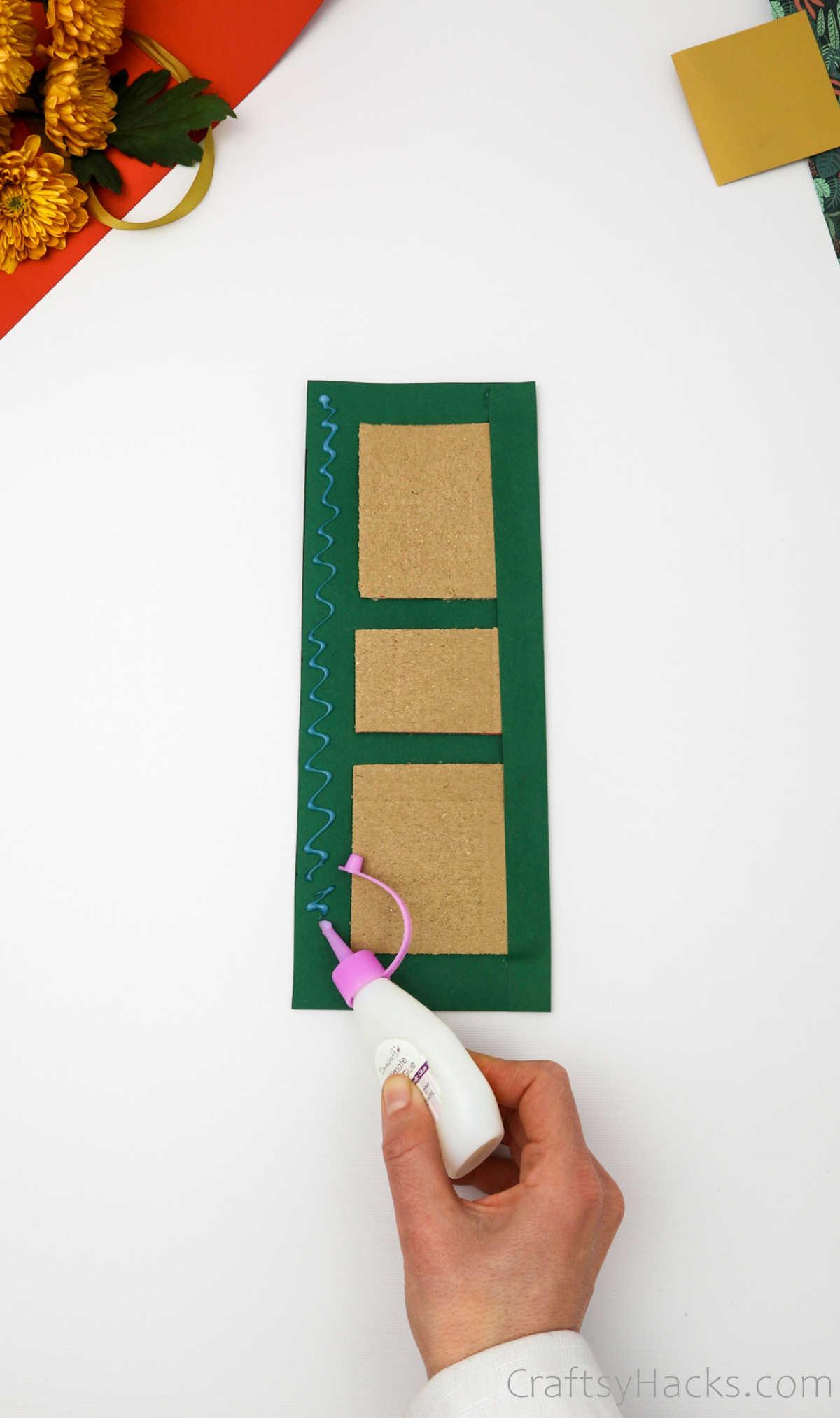 adding glue to paper