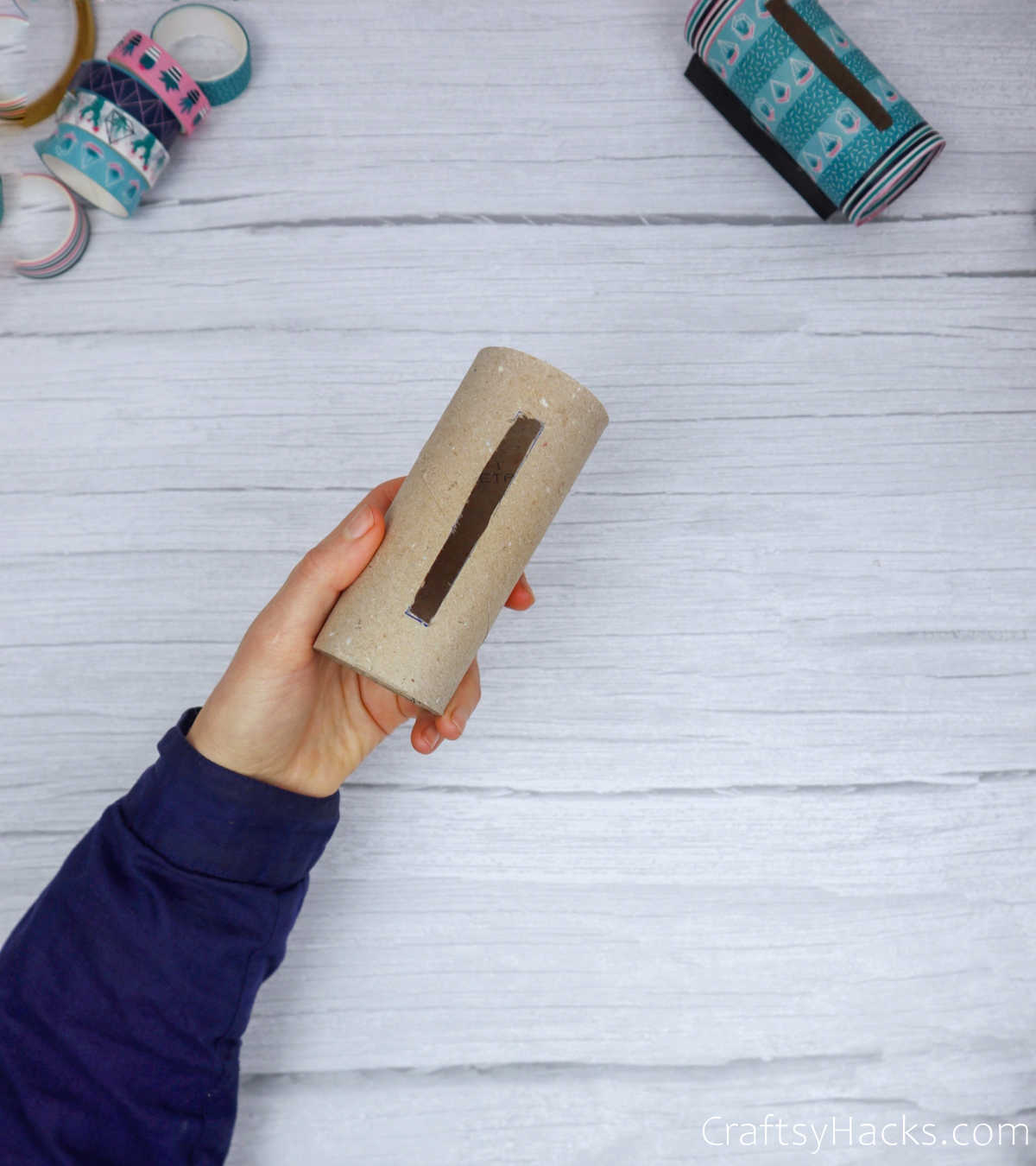 phone sized hole cut in paper roll