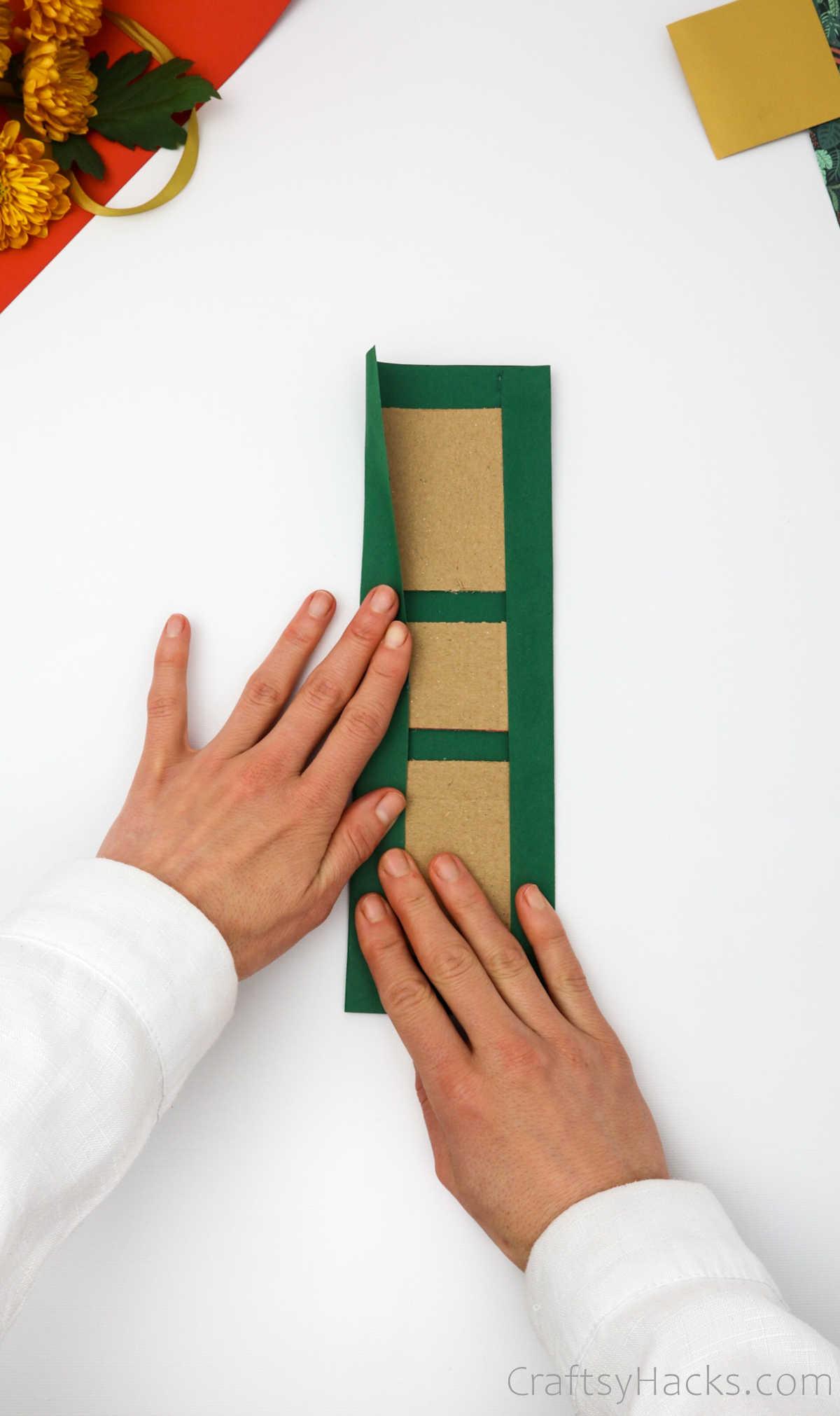 folding paper over cardboard
