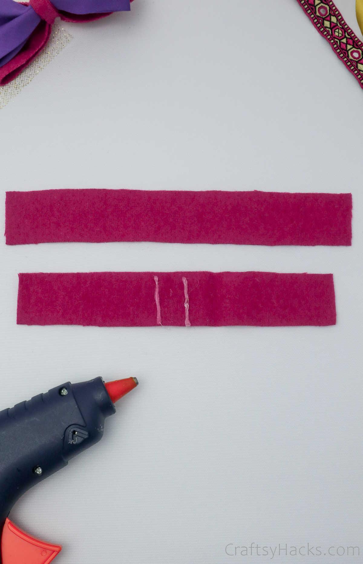 hot glue on pink felt piece