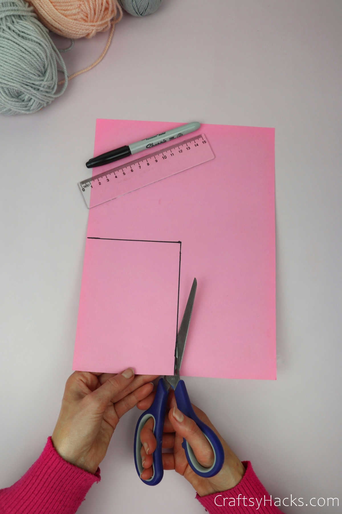 cutting out coloured paper