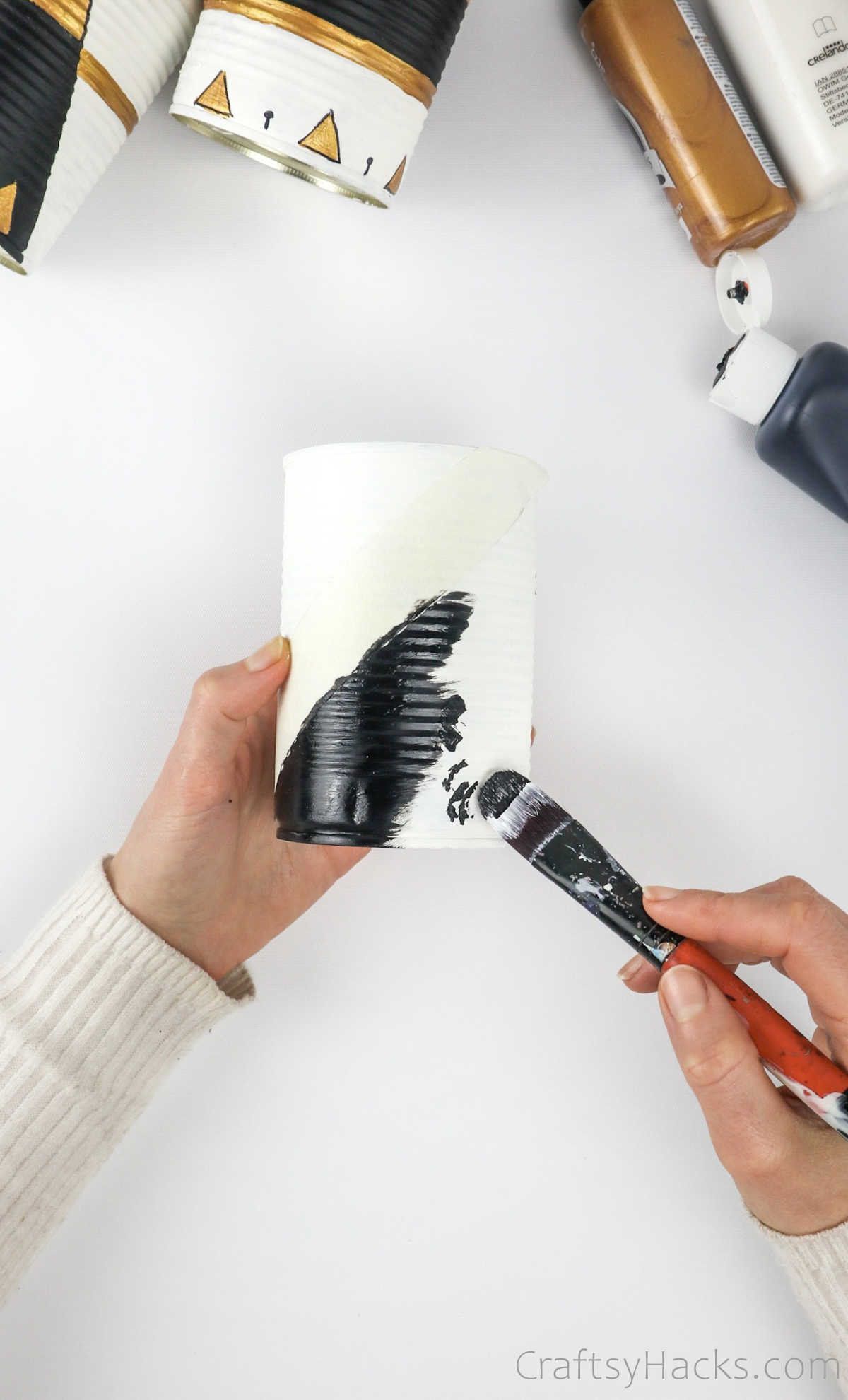 painting black on tin can