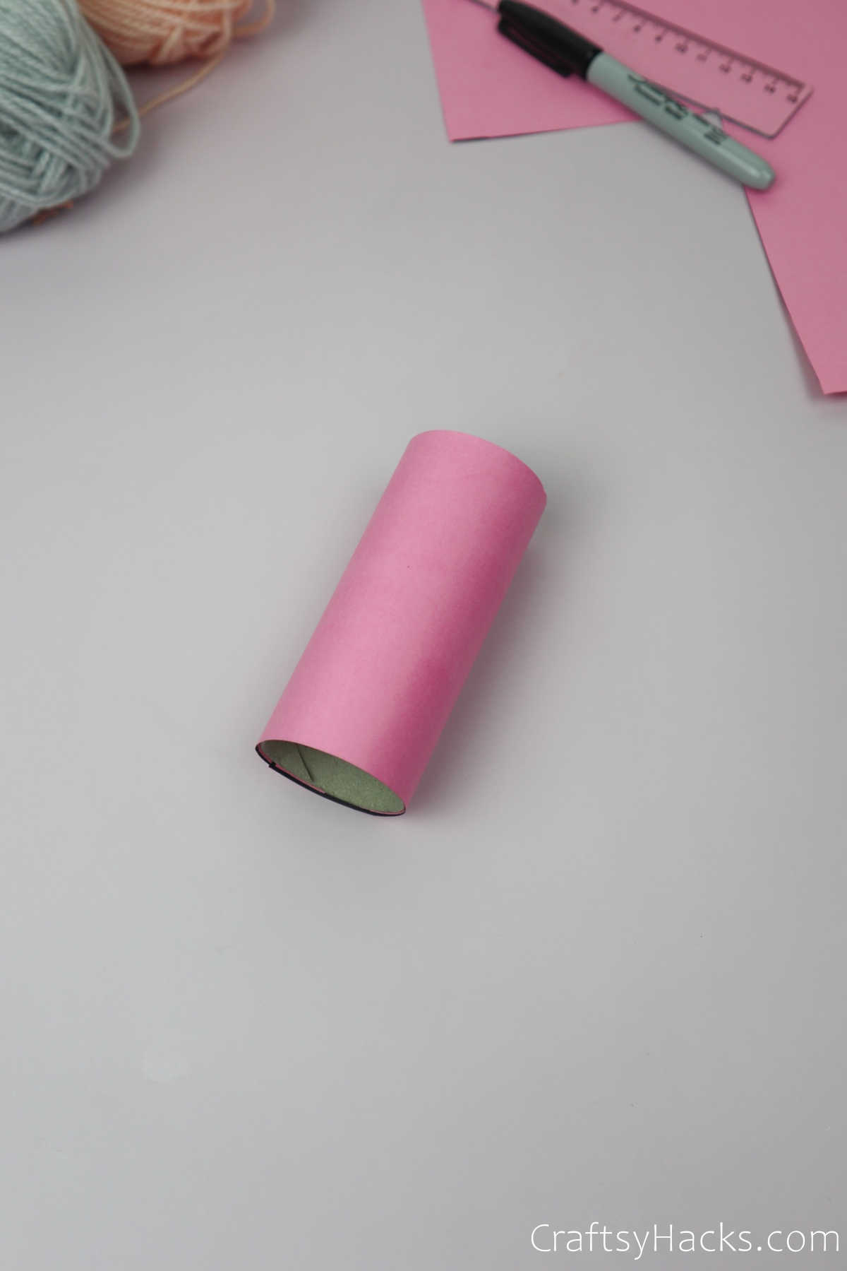wrapping coloured paper to paper roll