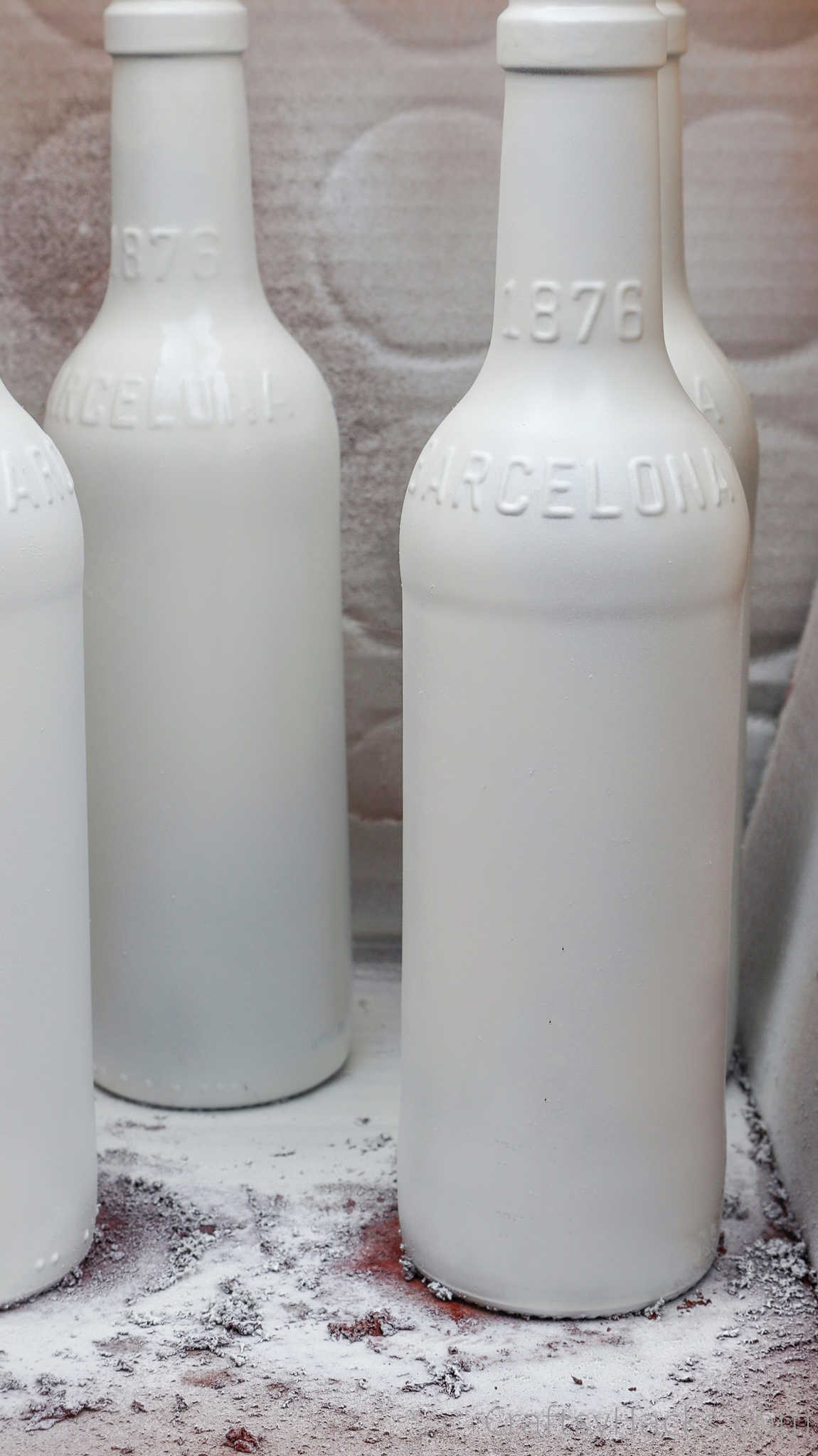 beer bottles painted white
