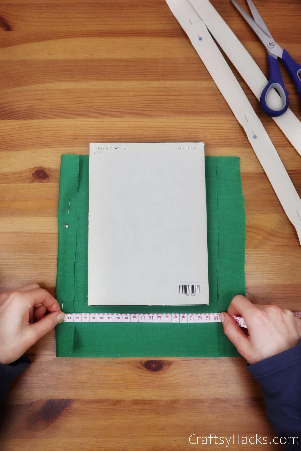 measuring green fabric