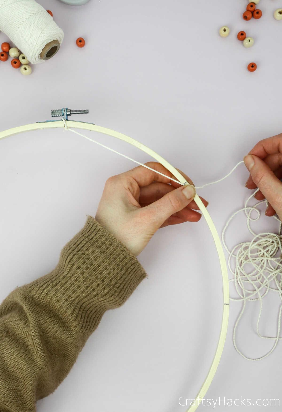 tying string to line on hoop