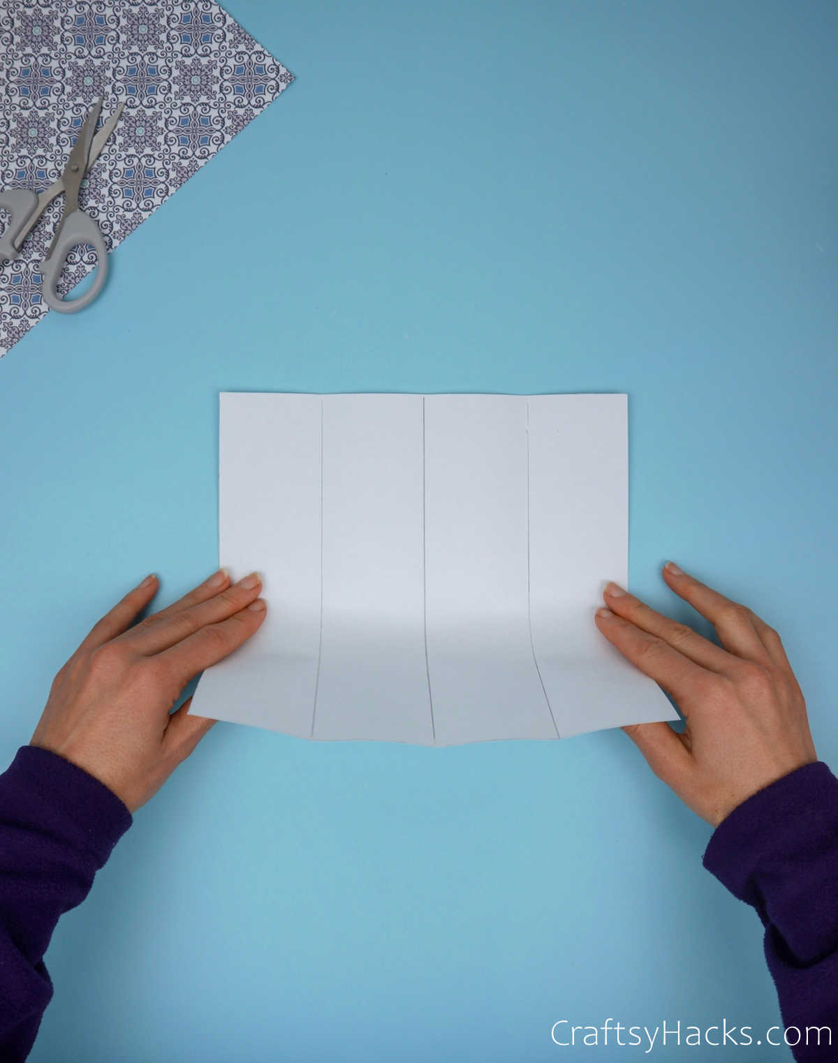 holding folded paper